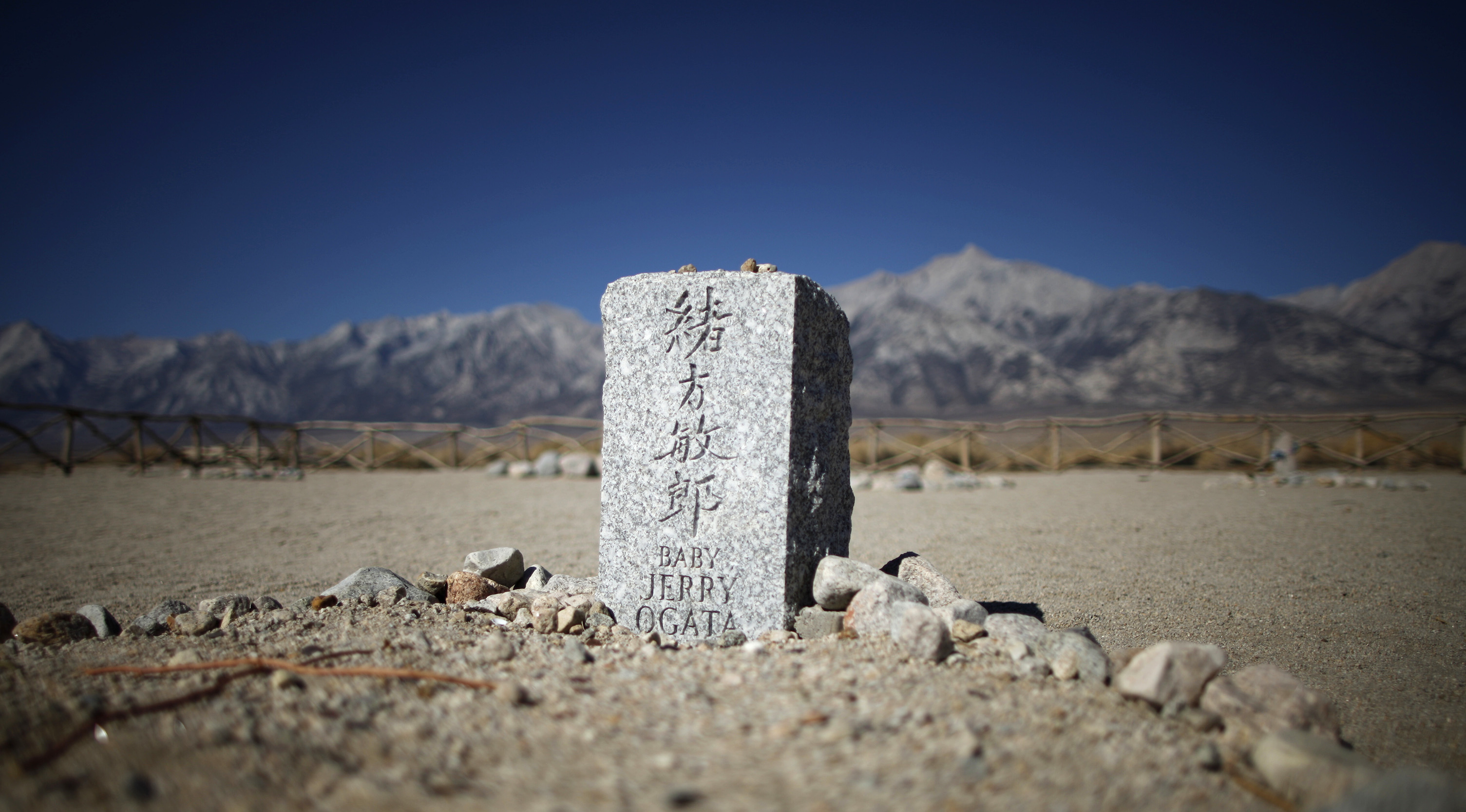 A gravestone is seen in the cemetery at Manzanar internment camp in Independence, California July 17, 2013. Nearly 120,000 people of Japanese ancestry were removed from their homes on the west coast by the U.S. Army and sent to Manzanar and nine other internment camps between March 1942 and November 1945. Two thirds of them were American citizens.