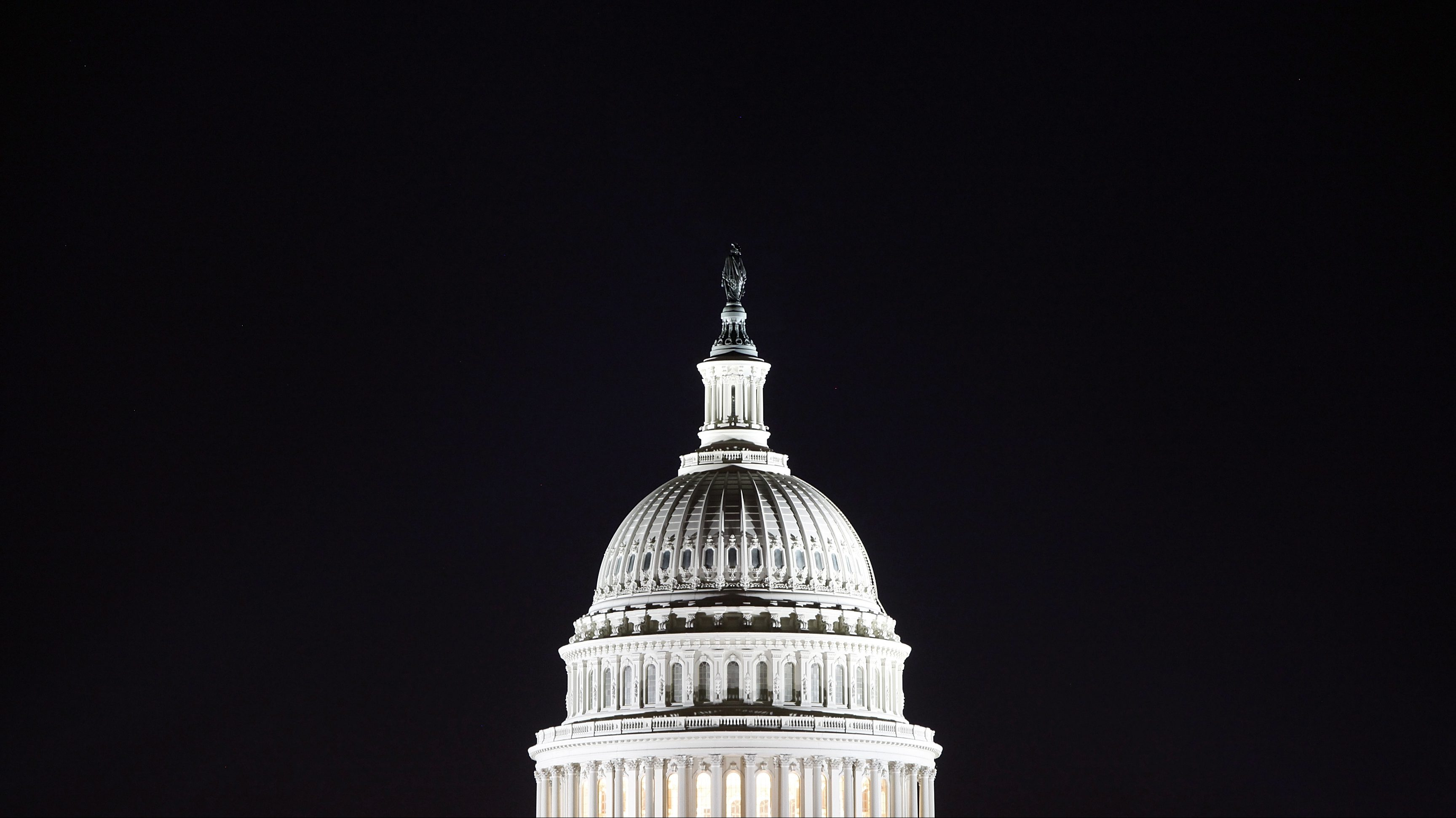 The U.S. Capitol dome is pictured in the pre-dawn darkness in this general view taken in Washington, October 18, 2013.  U.S. lawmakers launched an effort to resolve budget differences in a less confrontational fashion on Thursday as Washington picked up the pieces from a political crisis and 16-day government shutdown that has slowed the economy and undermined the country's international standing.   REUTERS/Jonathan Ernst    (UNITED STATES - Tags: POLITICS BUSINESS) - RTX14FVP