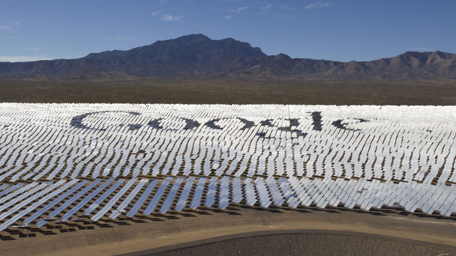The Google logo is spelled out in heliostats (mirrors that track the sun and reflect the sunlight onto a central receiving point) during a tour of the Ivanpah Solar Electric Generating System in the Mojave Desert near the California-Nevada border February 13, 2014. The project, a partnership of NRG, BrightSource, Google and Bechtel, is the world's largest solar thermal facility and uses 347,000 sun-facing mirrors to produce 392 Megawatts of electricity, enough energy to power more than 140,000 homes. REUTERS/Steve Marcus (UNITED STATES - Tags: ENERGY SCIENCE TECHNOLOGY BUSINESS TPX IMAGES OF THE DAY LOGO) - RTX18S4Z