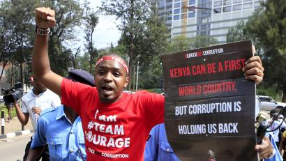 Kenyan activist Boniface Mwangi is detained by police during a street protest on corruption in Kenya's capital Nairobi December 1, 2015.