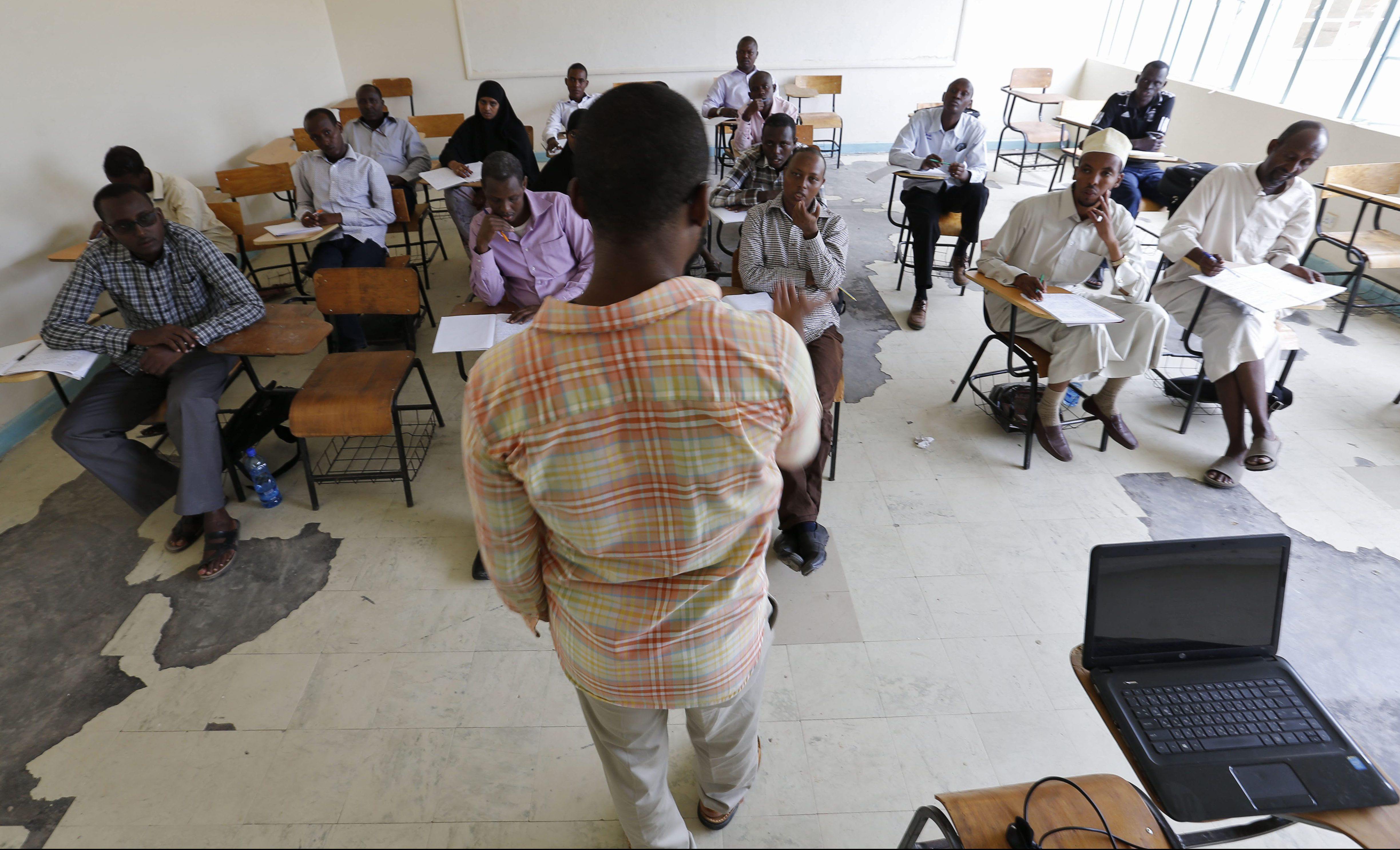 A lecturer teaches third-year students as they return to the Garissa University College in Garissa