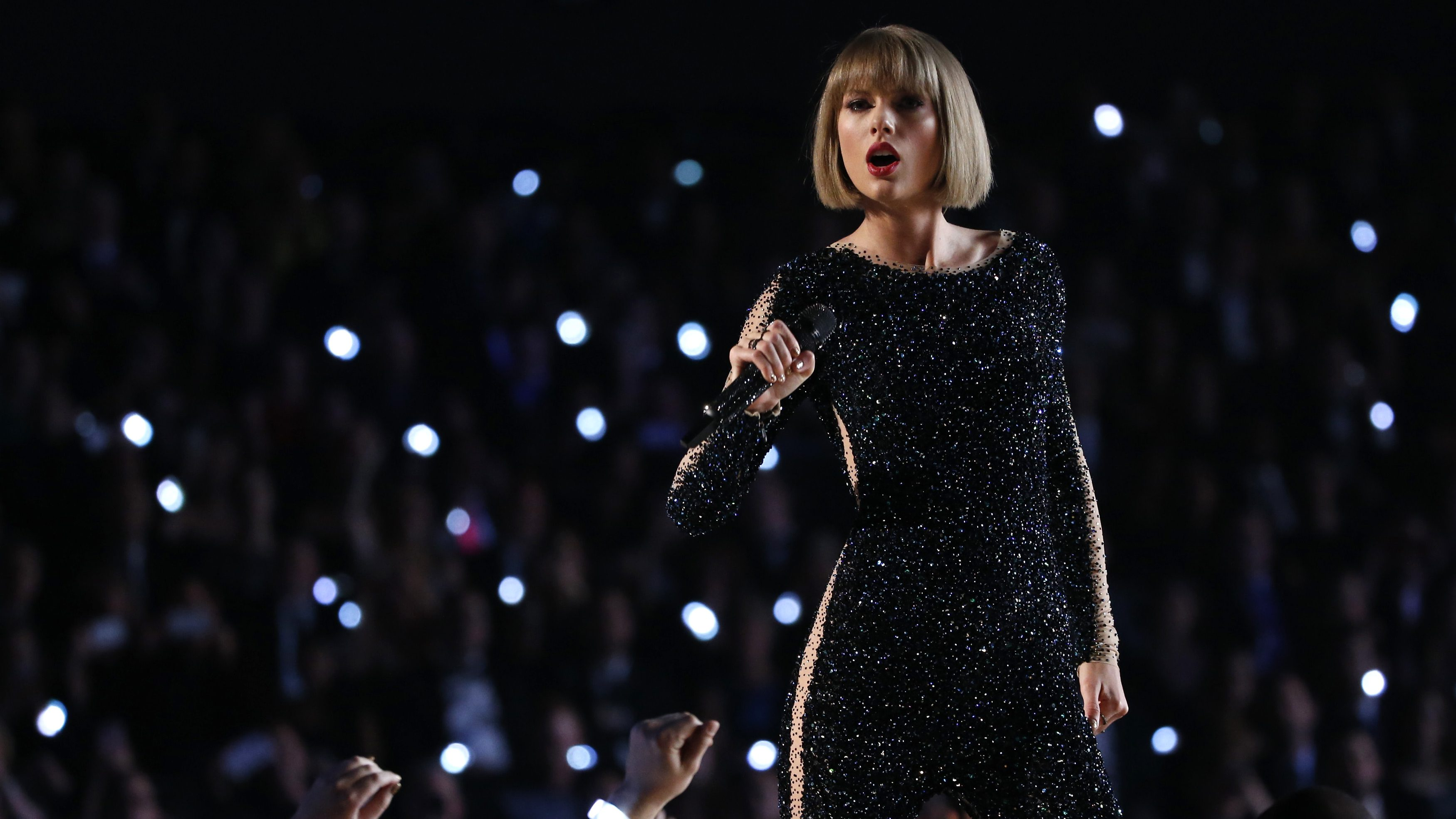 """Taylor Swift performs """"Out of the Woods"""" at the 58th Grammy Awards in Los Angeles"""