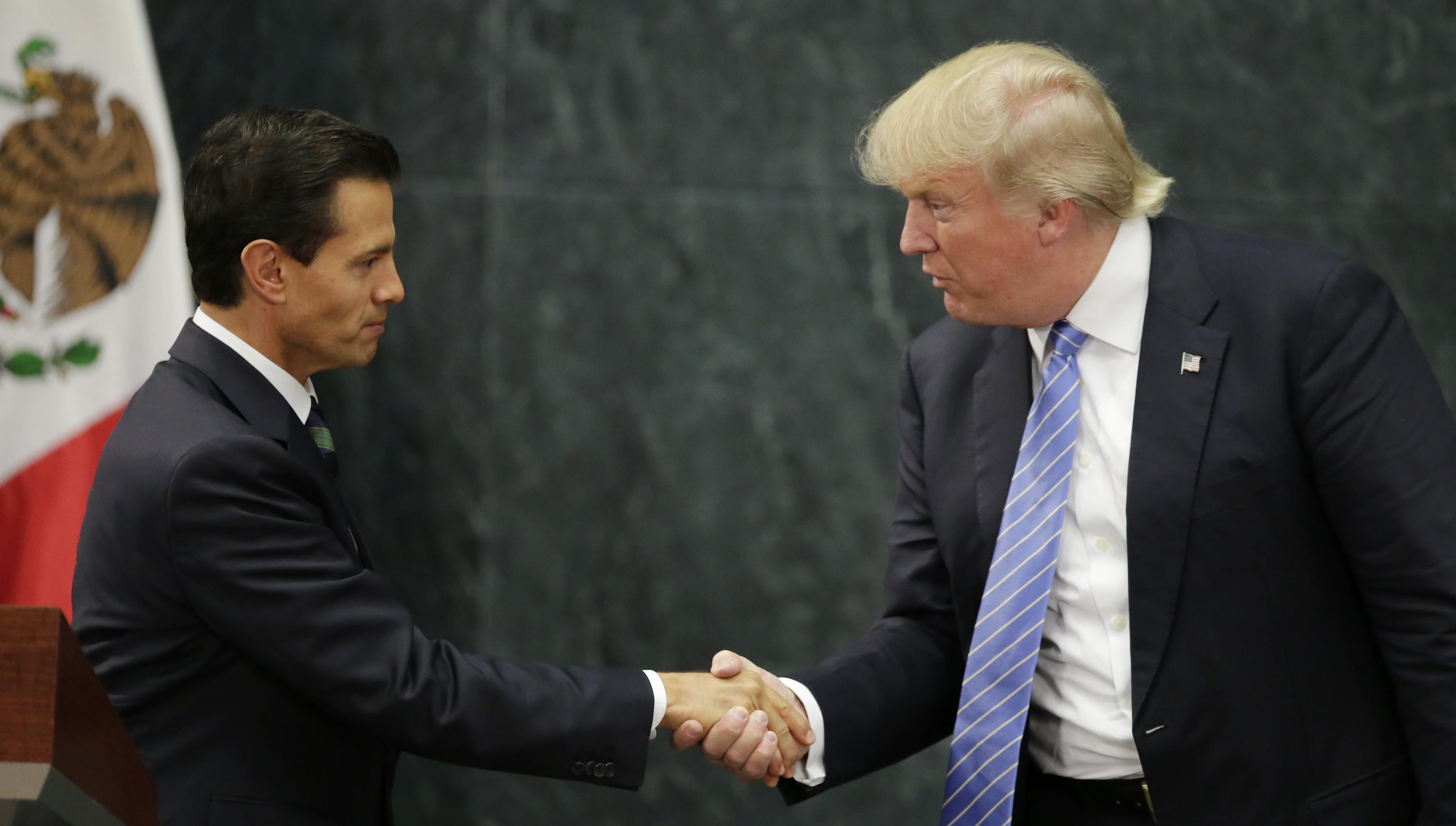 Donald Trump and Mexico's President Enrique Pena Nieto shake hands at a press conference