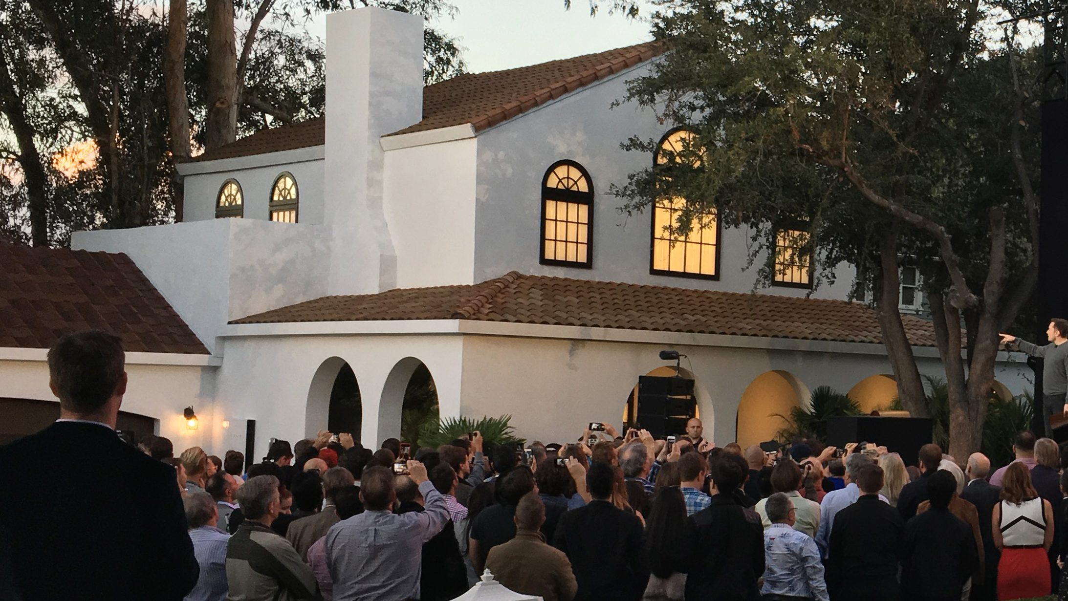 Tesla's electric car, Powerwall and solar roof are shown at an unveiling of new energy products aimed at illustrating the benefits of combining his electric car and battery maker with solar installer SolarCity Corp, in Los Angeles