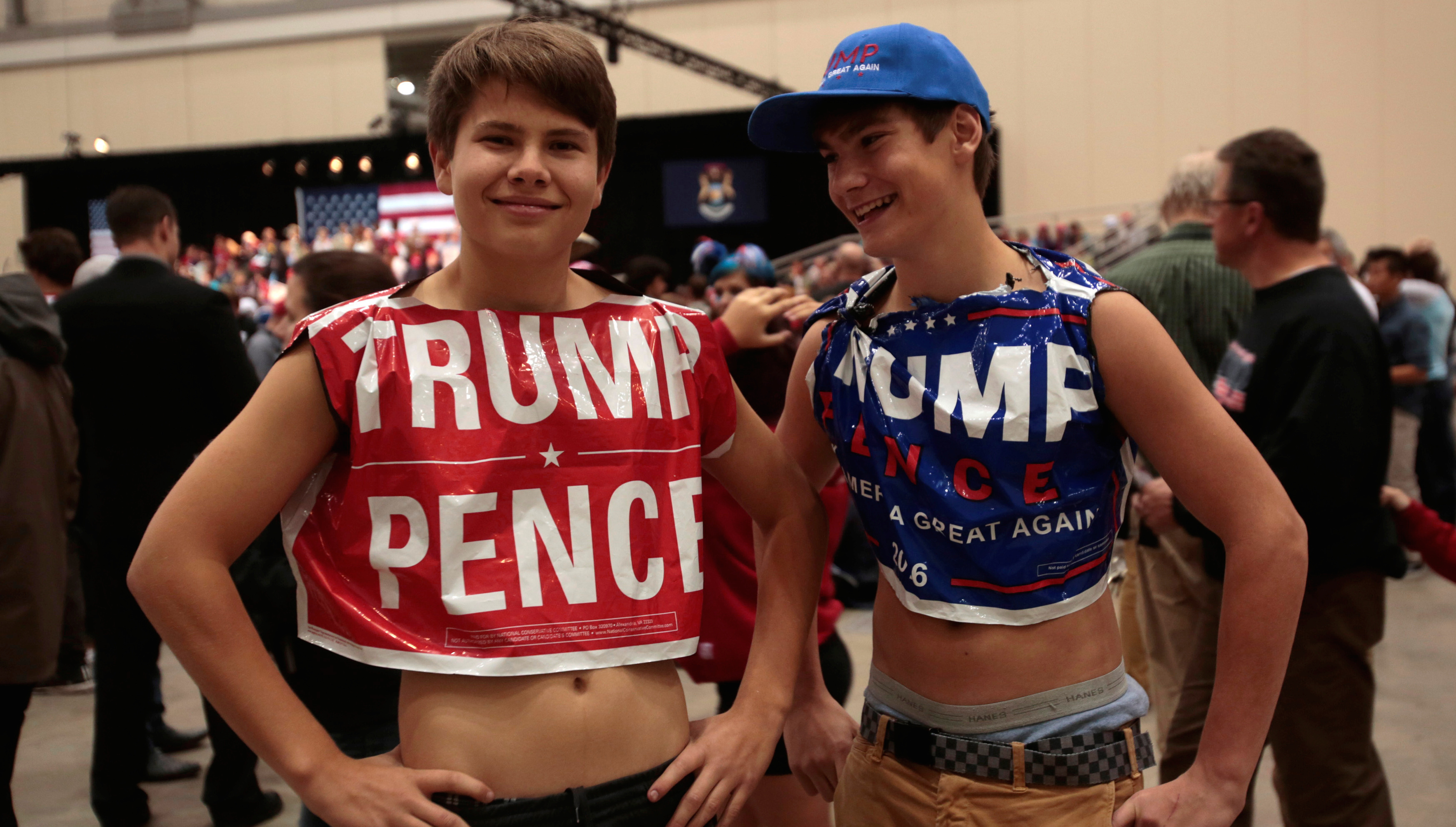 U.S. Republican presidential nominee Donald Trump supporters Mick Ventocilla (L) and Nick Giddings come dressed as 'campaign lawn signs' to hear Trump speak at the Devos Place in Grand Rapids, Michigan November 7, 2016.