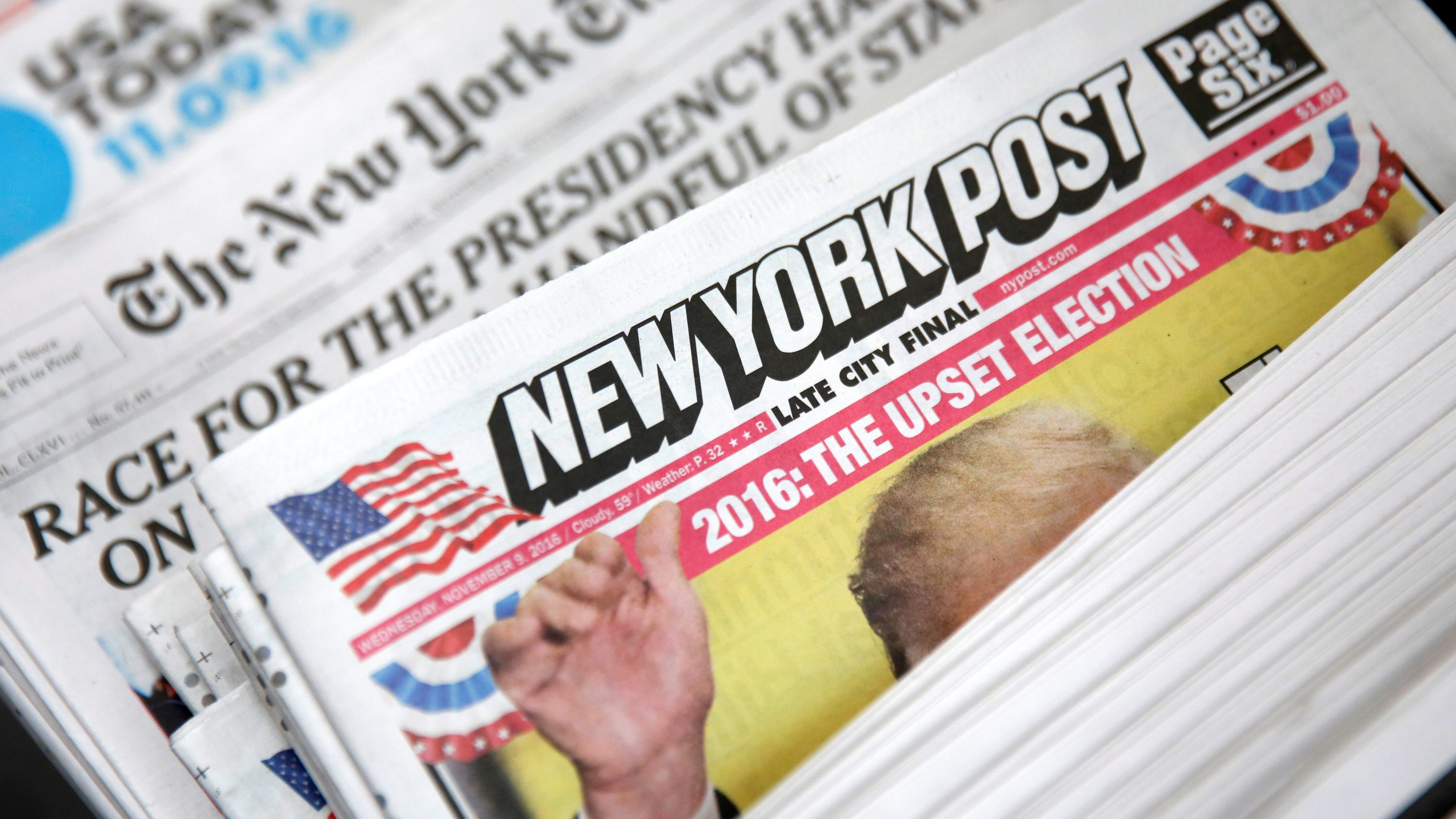 The cover of the New York Post newspaper is seen with other papers at a newsstand in New York U.S., November 9, 2016.