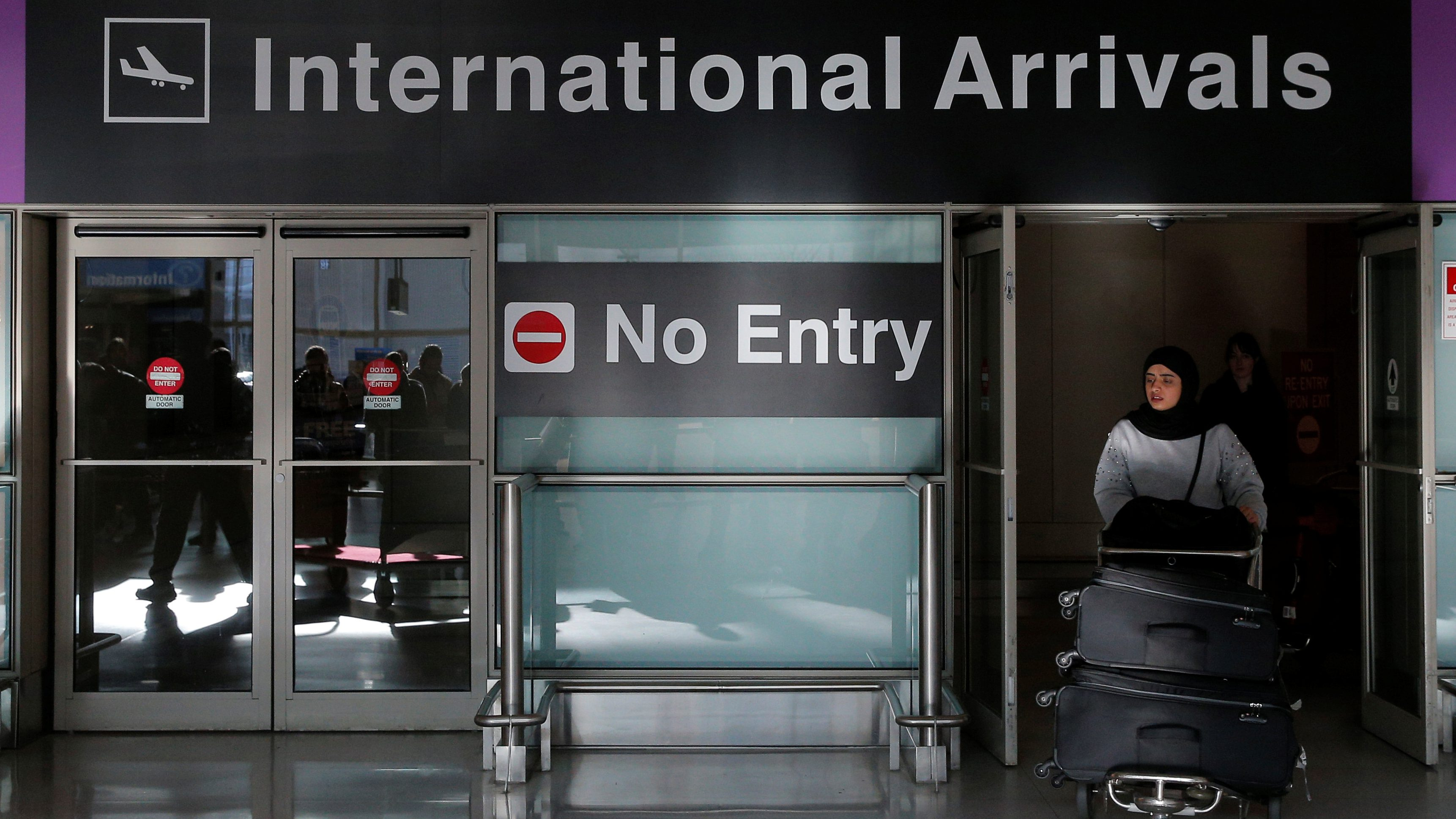An international traveler arrives after U.S. President Donald Trump's executive order travel ban at Logan Airport in Boston, Massachusetts, U.S. January 30, 2017.   REUTERS/Brian Snyder - RTX2YWC1