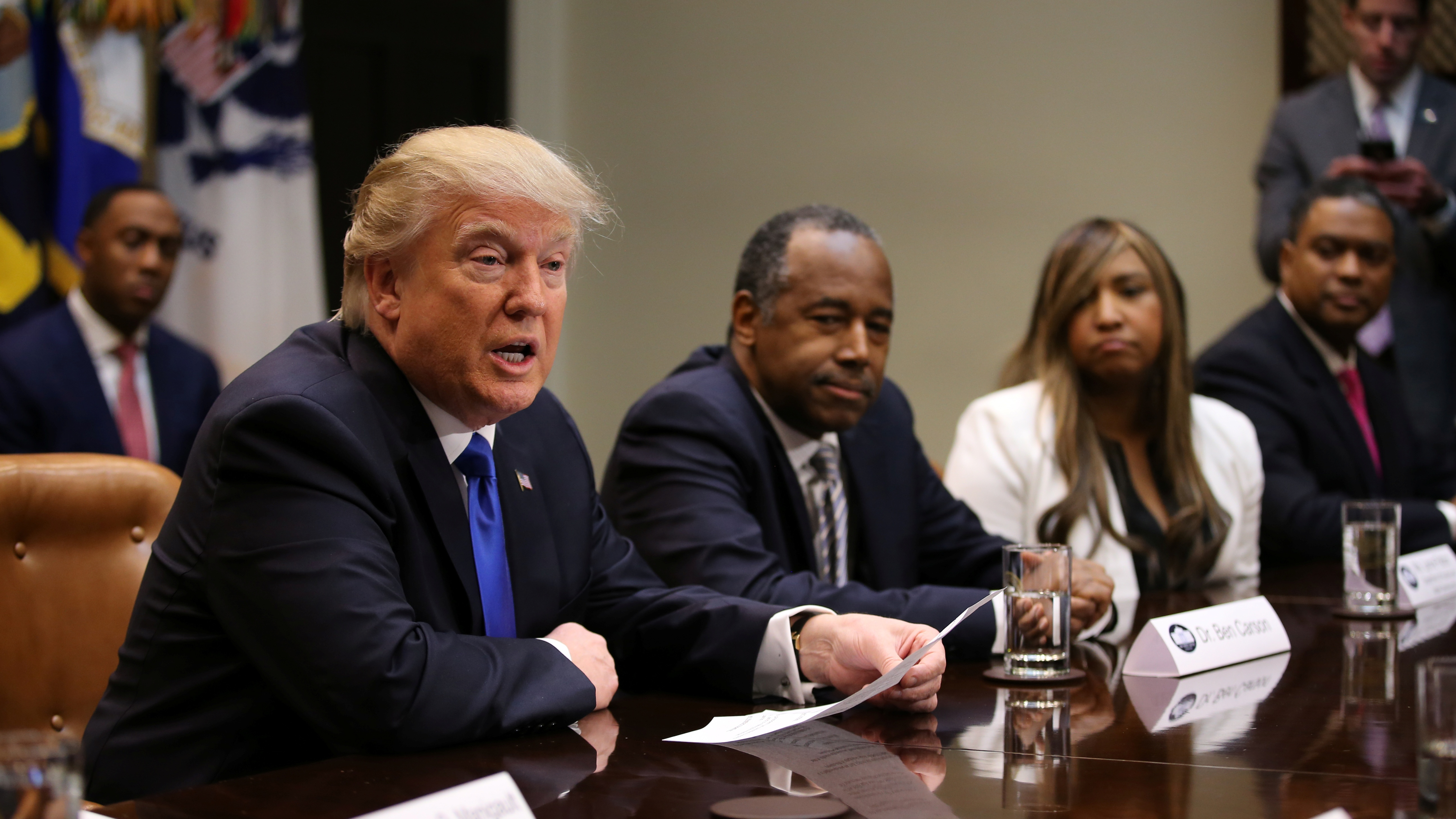U.S. President Donald Trump attends an African American History Month listening session, accompanied by the Housing and Urban Development Secretary Ben Carson (C) at the Roosevelt room of the White House in Washington, U.S., February 1, 2017. REUTERS/Carlos Barria