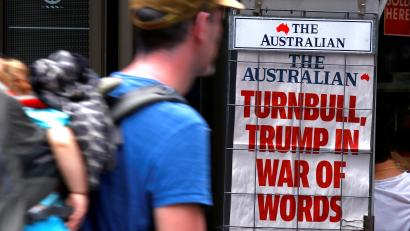 A pedestrian looks at a newspaper headline regarding U.S. President Donald Trump and Australian Prime Minister Malcolm Turnbull in central Sydney, Australia, February 3, 2017.