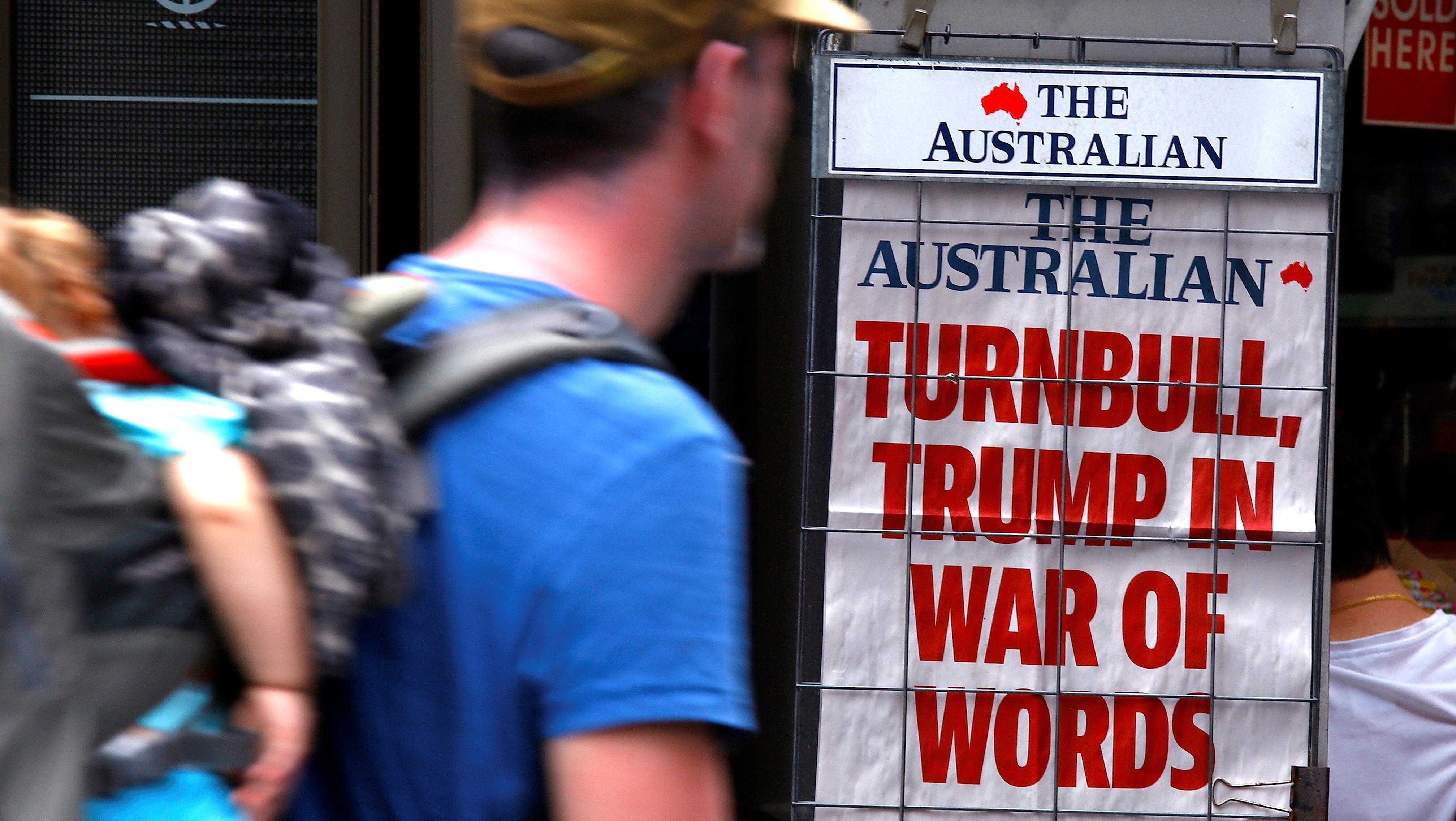 A pedestrian looks at a newspaper headline regarding U.S. President Donald Trump and Australian Prime Minister Malcolm Turnbull in central Sydney, Australia, February 3, 2017.