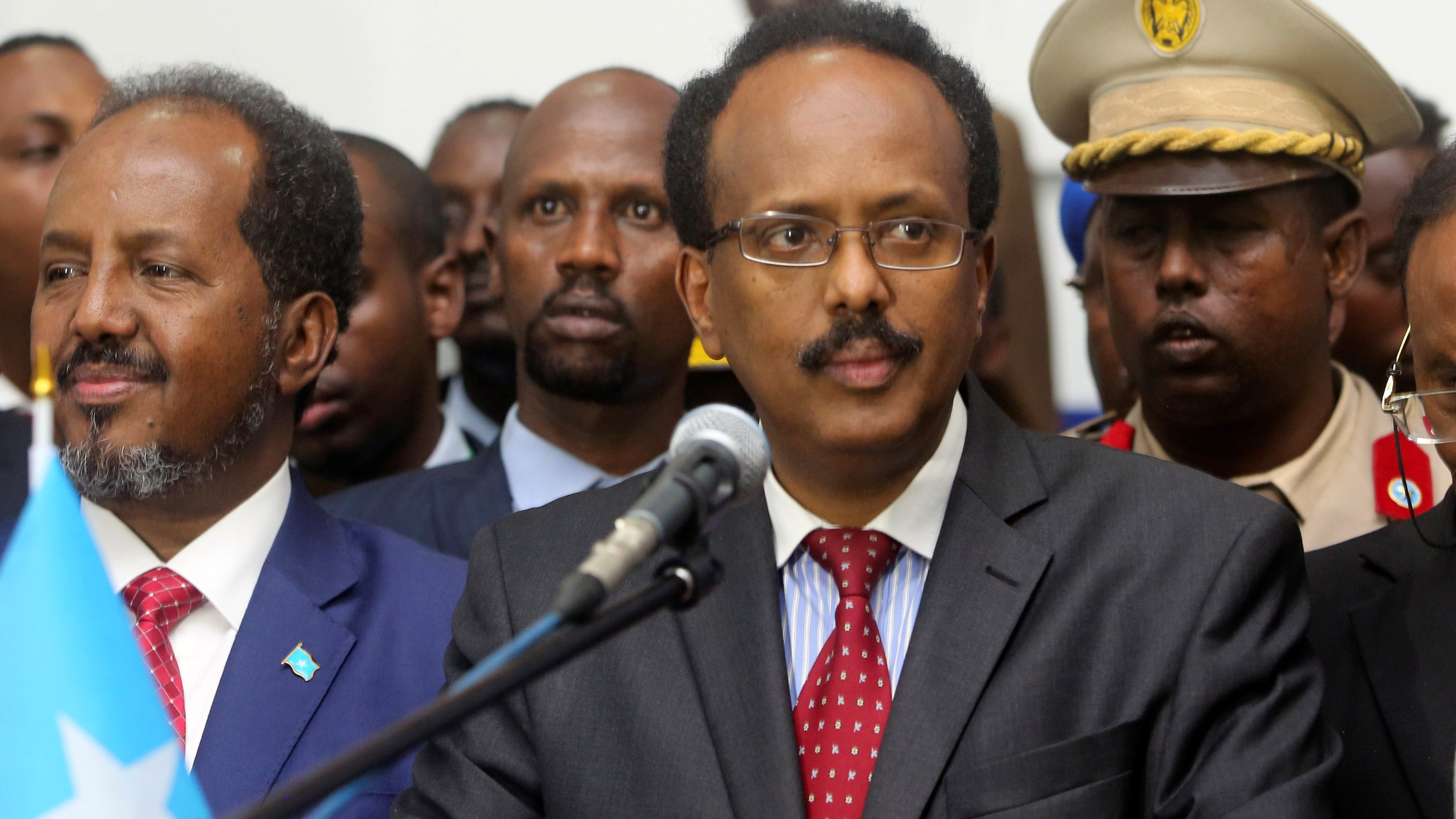 Somalia's newly elected President Mohamed Abdullahi Farmajo flanked by outgoing president Hassan Sheikh Mohamud (L) addresses lawmakers after winning the vote at the airport in Somalia's capital Mogadishu, February 8, 2017.