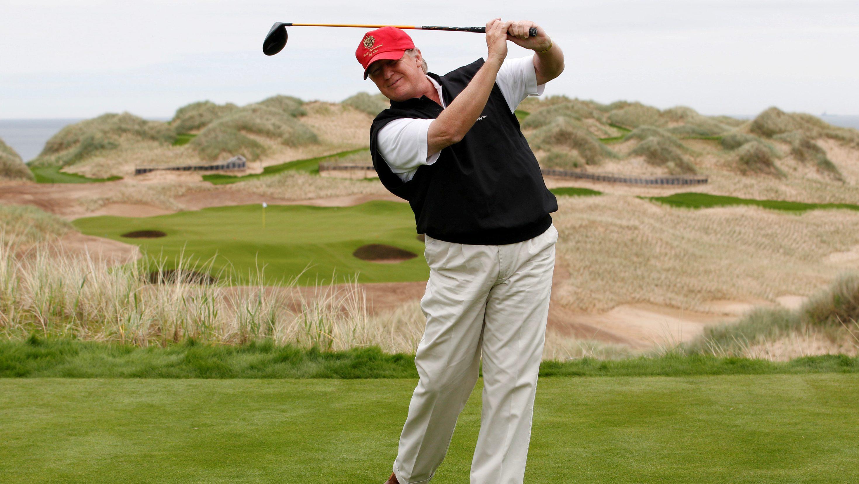 Donald Trump swings a golf club in Scotland.