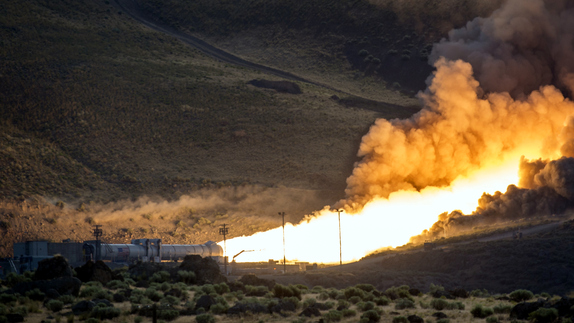 The second and final qualification motor (QM-2) test for the Space Launch System's booster is seen, Tuesday, June 28, 2016, at Orbital ATK Propulsion Systems test facilities in Promontory, Utah. During the Space Launch System flight the boosters will provide more than 75 percent of the thrust needed to escape the gravitational pull of the Earth, the first step on NASA's Journey to Mars.