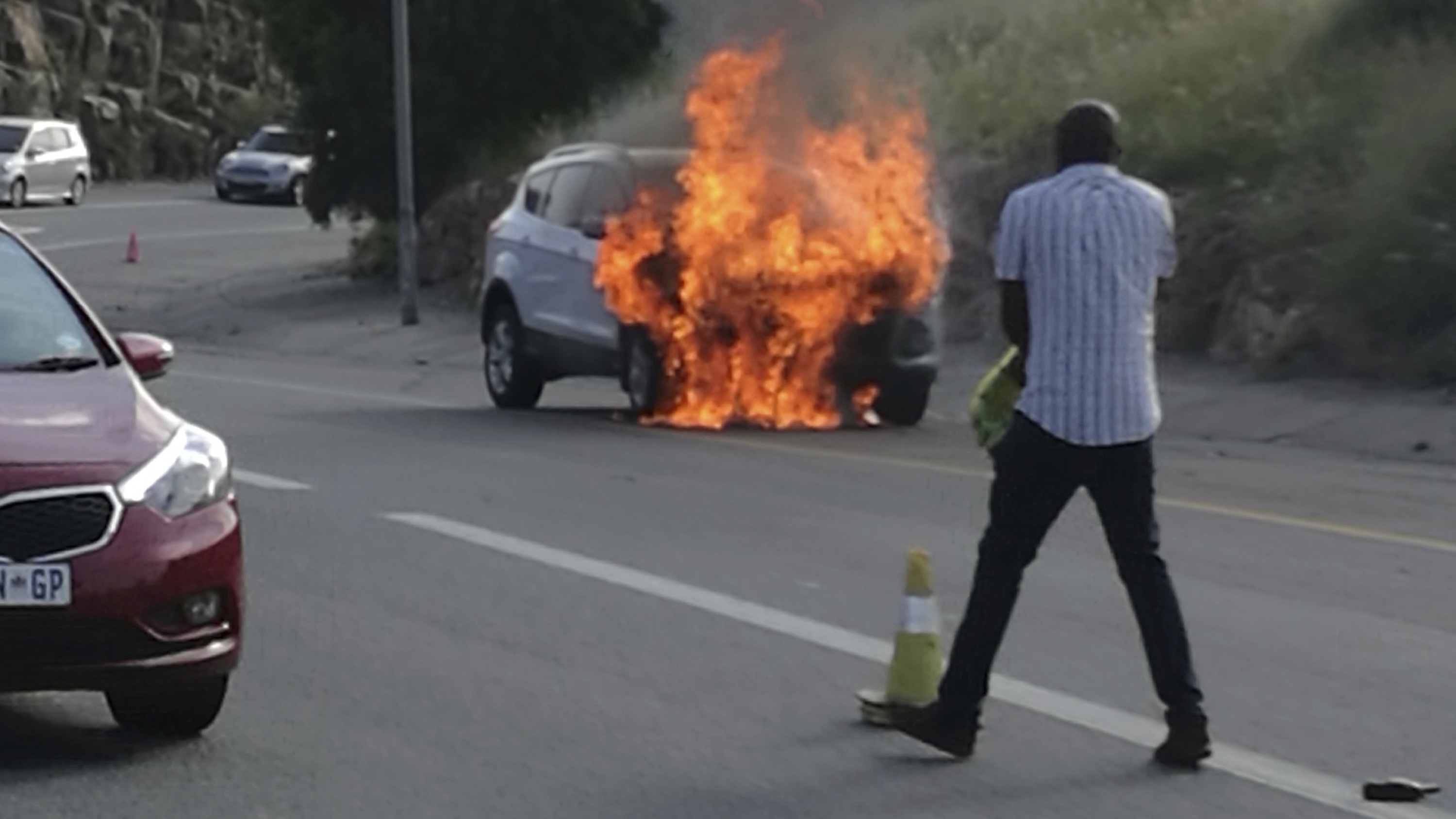 In this photo taken Thursday, Jan. 12, 2017 the 2013 Ford Kuga owned by Warren Krog burns out in Alberton Johannesburg. The South African unit of the Ford car company says it is recalling 4,556 Kuga SUVs following several dozen reports of the car catching fire. Jeff Nemeth, Ford's regional chief executive, said Monday Jan. 16 2017, that 1.6-liter Kugas made between December 2012 and February 2014 must be taken to a Ford dealer as soon as possible. (AP Photo/Warren Krog)