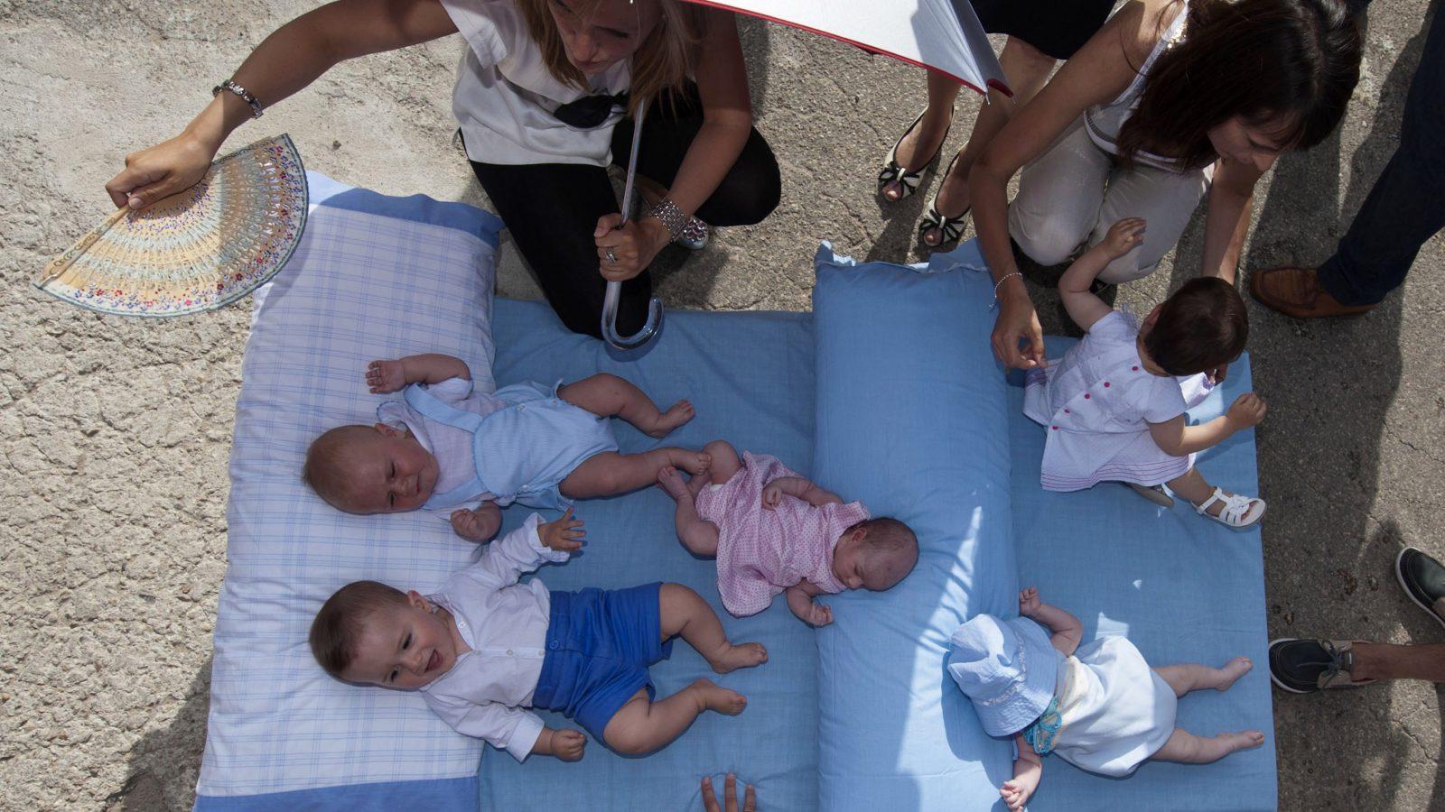 Babies on a mattress in Spain.