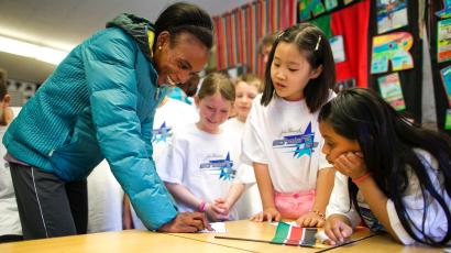 Kenyan marathoner Rita Jeptoo teaches Swahili in a Massachusetts school.
