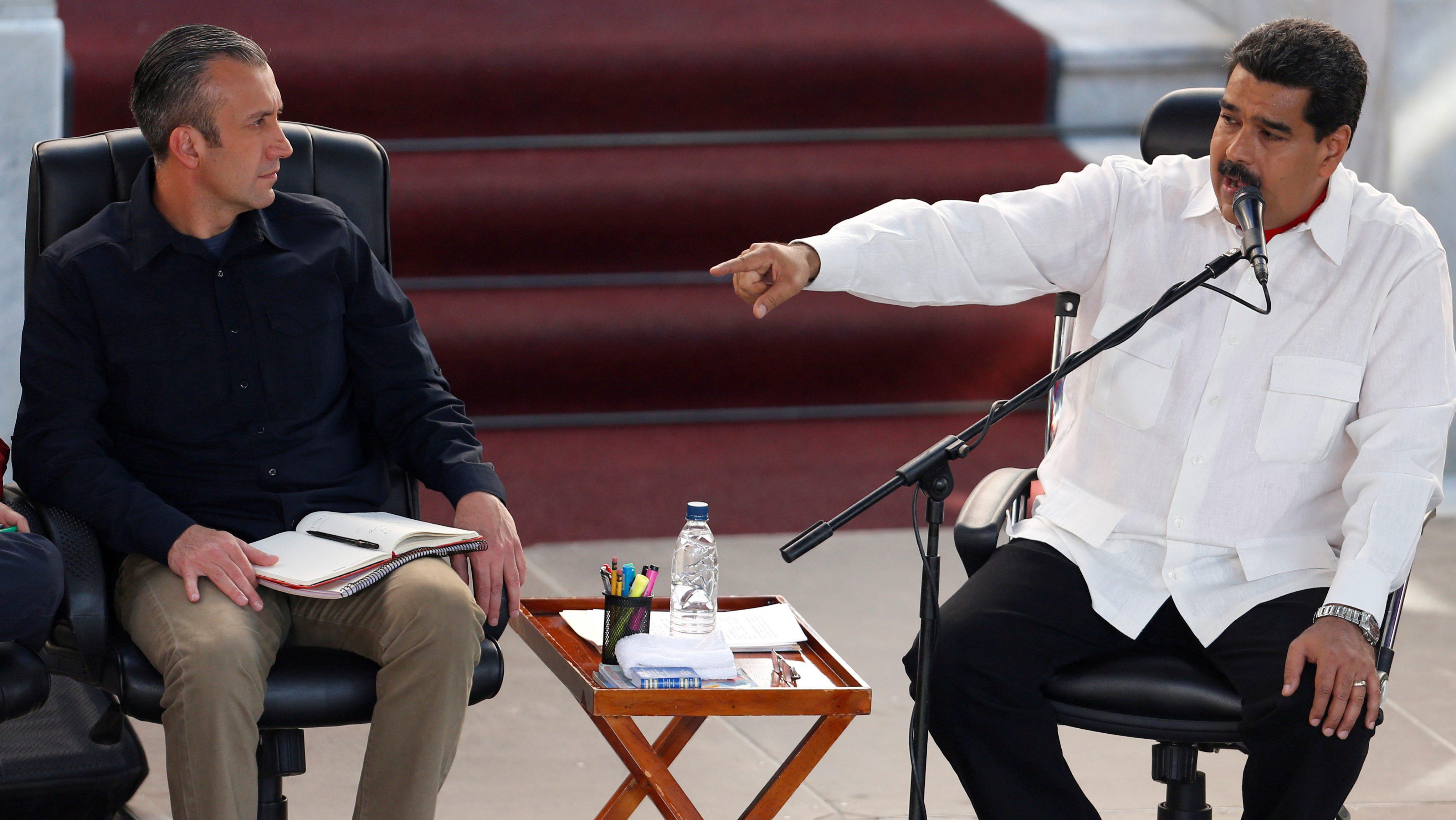 President Nicolas Maduro (R) speaks next to Venezuela's Vice President Tareck El Aissami