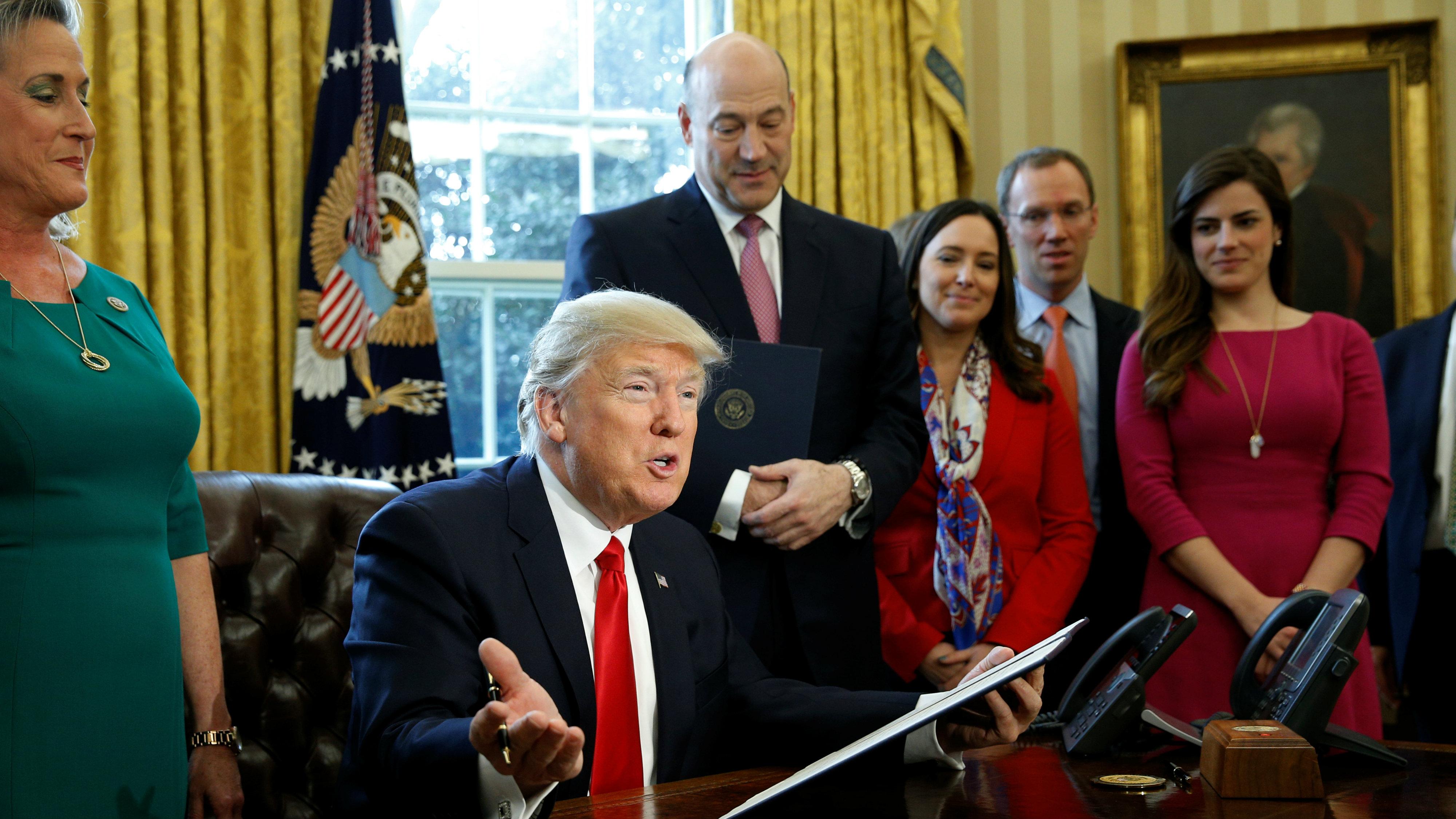 Donald Trump signs an executive order to review bank regulations
