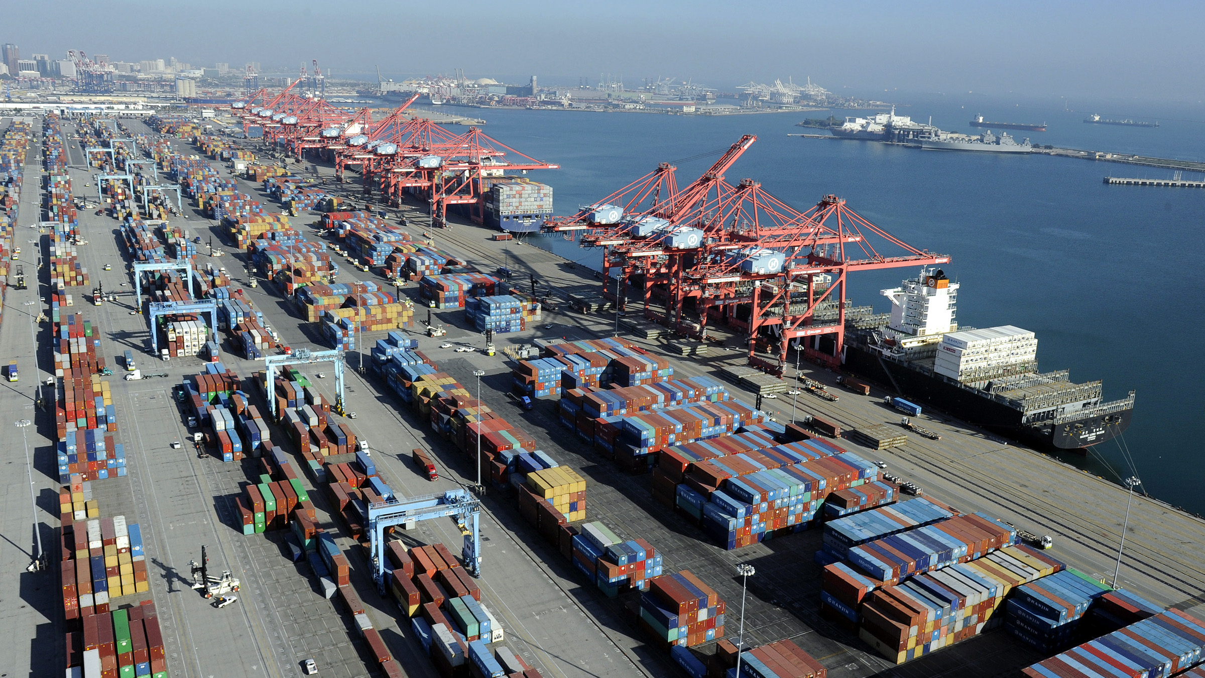 Containers and ships sit idle at the Port of Long Beach, California in this aerial photo taken February 6, 2015. The loading and unloading of cargo freighters has been suspended at all 29 U.S. West Coast ports this weekend because of chronic slowdowns on the docks that shippers and terminal operators have blamed on the dockworkers' union, the companies said Friday.