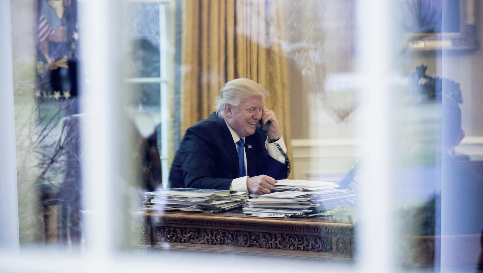 President Donald Trump speaks with German Chancellor Angela Merkel in the Oval Office at the White House in Washington, Saturday, Jan. 28, 2017. (AP Photo/Andrew Harnik)