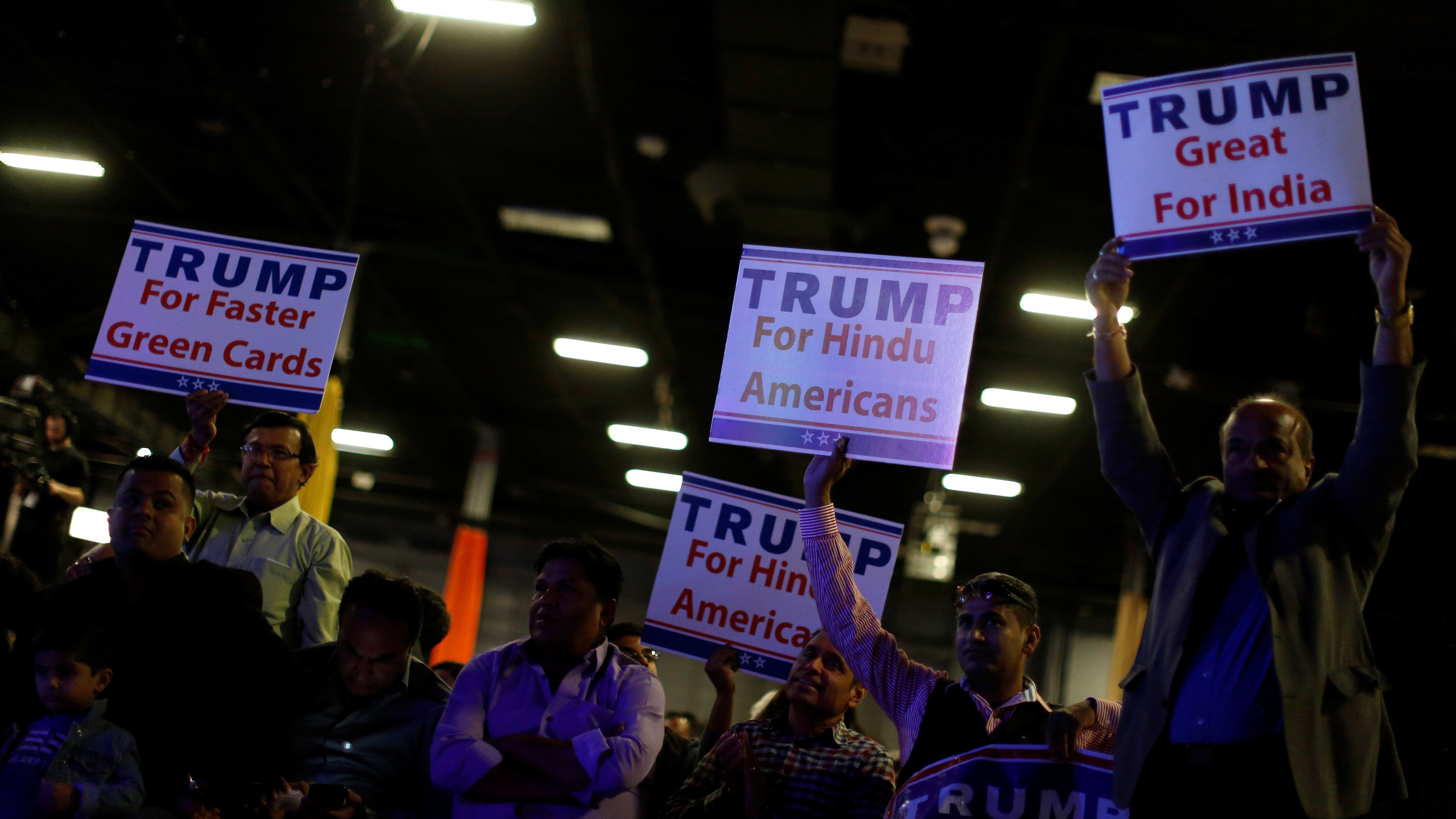 People wait for Republican presidential nominee Donald Trump to take the stage at a Bollywood-themed charity concert put on by the Republican Hindu Coalition in Edison, New Jersey, U.S. October 15, 2016. REUTERS/Jonathan Ernst - RTX2P03S
