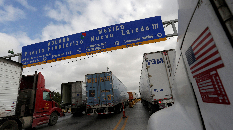 Trucks wait in the queue for border customs control to cross into U.S. at the World Trade Bridge in Nuevo Laredo, Mexico
