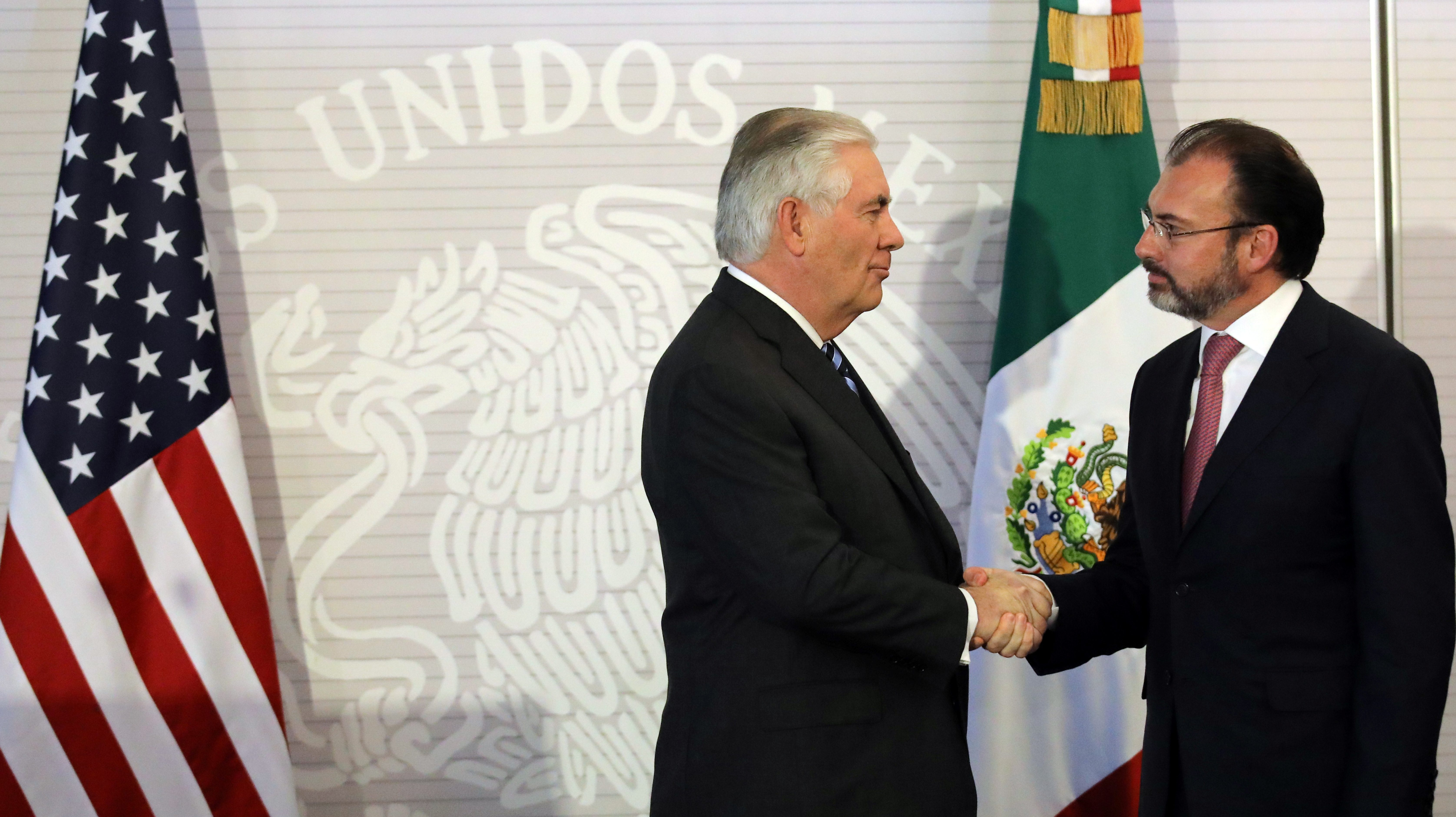 U.S. Secretary of State Rex Tillerson (L) shakes hands with Mexico's Foreign Secretary Luis Videgaray