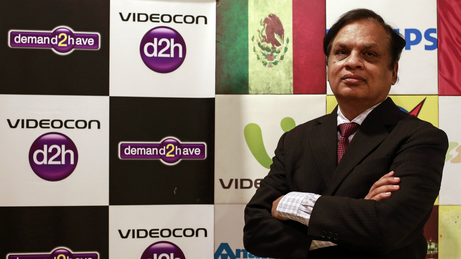 Videocon Group Chairman Venugopal Dhoot poses for a picture at the company corporate office in Mumbai January 7, 2015. Satellite television operator Videocon d2h Ltd has agreed to sell shares worth up to $375 million to U.S. based Silver Eagle Acquisition Corp EAGLU.PK and the proceeds will be used to expand its services.