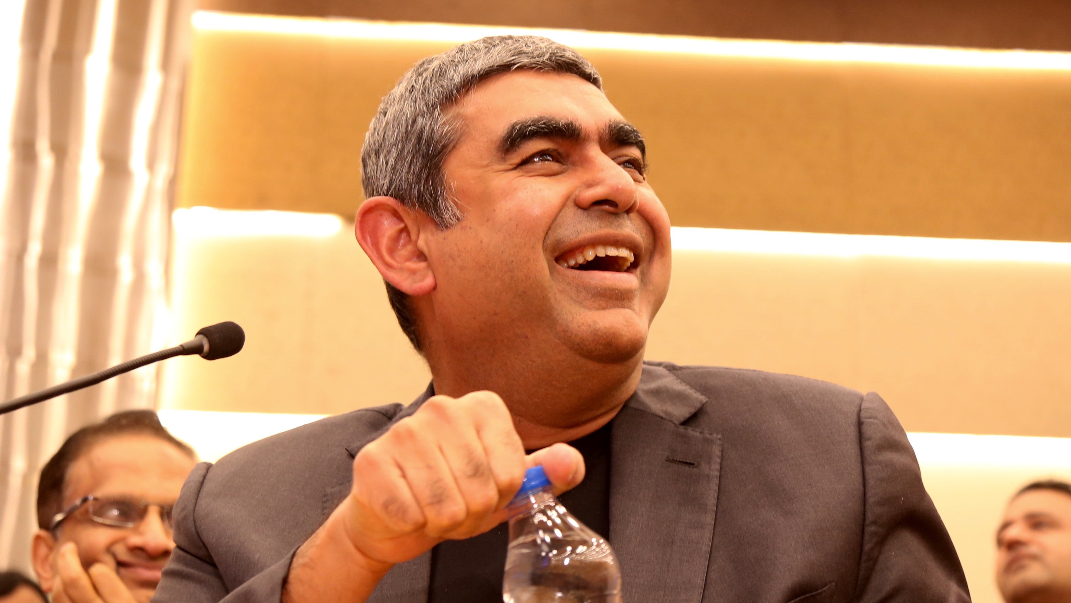 epa05585027 Vishal Sikka, CEO and Managing Director of Indian multinational corporation Infosys Limited, speaks during a press conference to announce the Q2  results at the Infosys headquarters, in Bangalore, India, 14  October 2016. The Indian second largest information technology and consulting company reported net profit 6.1 percent, beating market expectations as it racked up new business client wins.  EPA/JAGADEESH NV