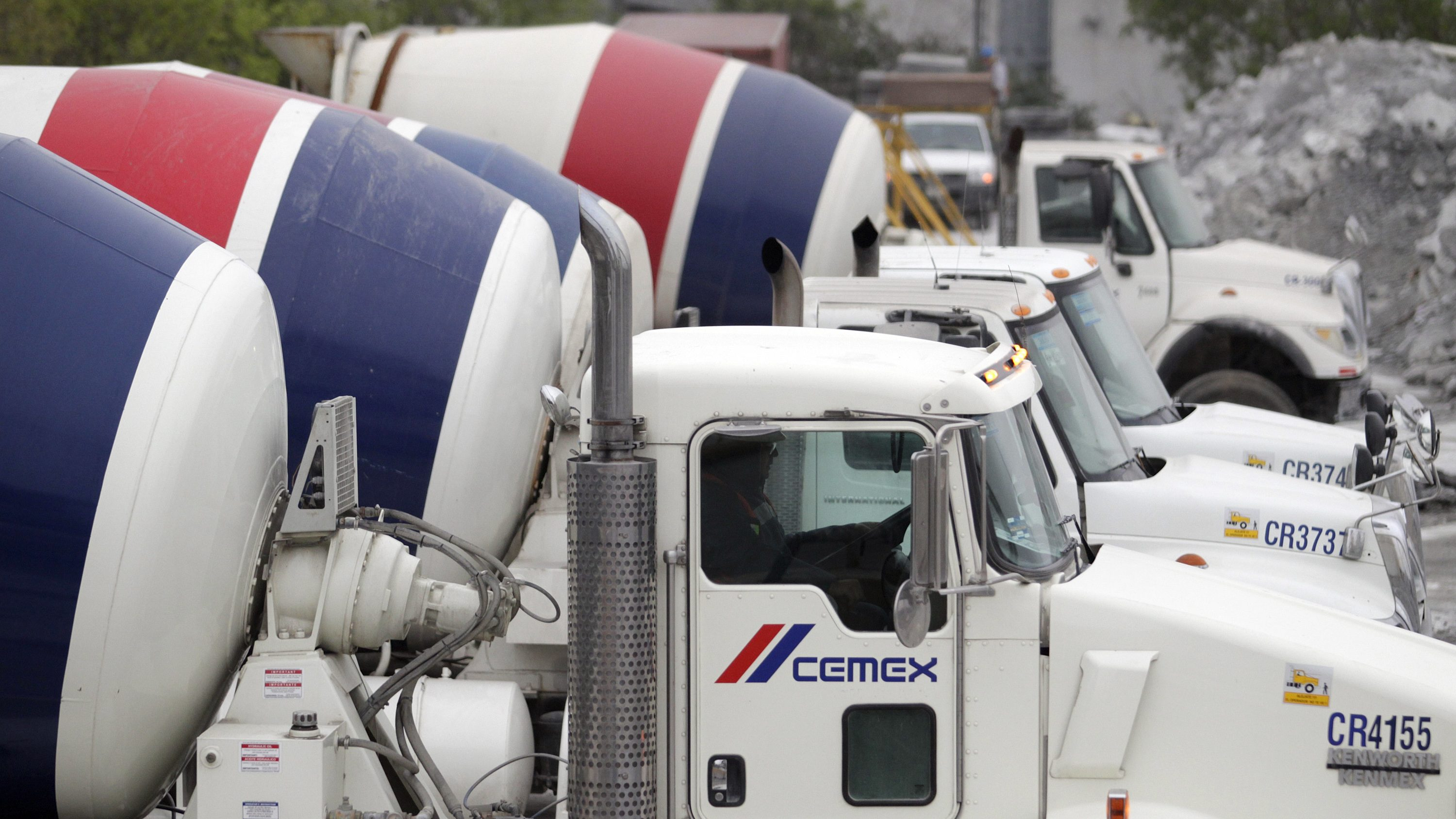 Concrete mixer trucks are lined up at a concrete plant of Mexican cement maker CEMEX, in Monterrey February 24, 2015.