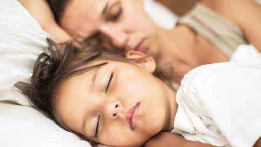 Mother and child sleeping.