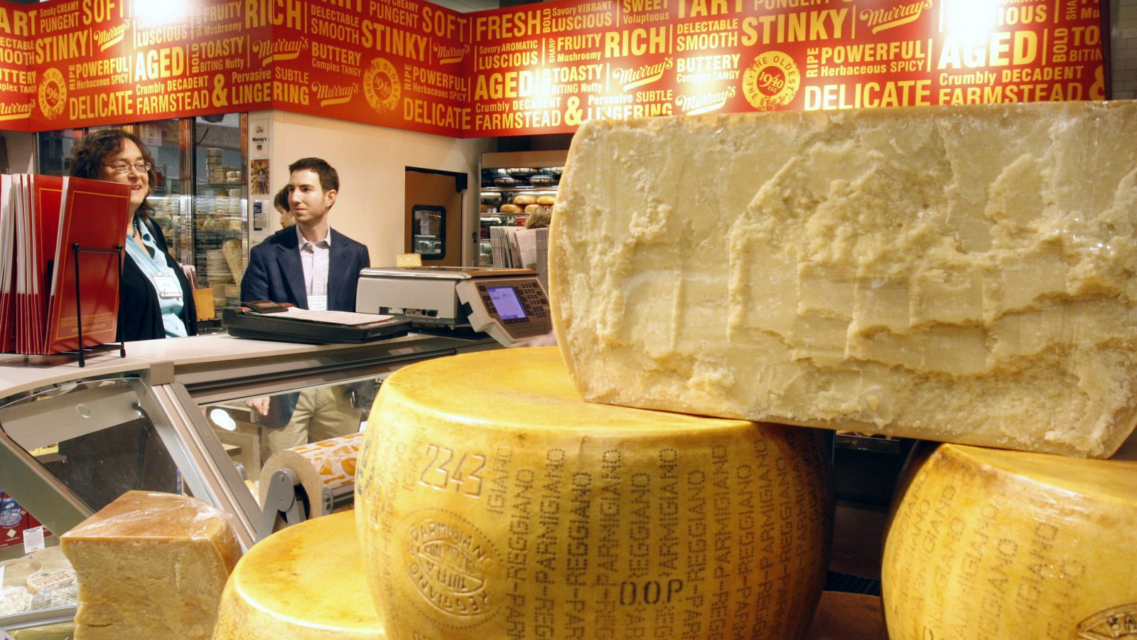 Vendors and members of the media look over Murray's Cheese from New York, a specialty cheese shop inside Kroger's Fresh Fare store, Monday, Nov. 17, 2008, in Cincinnati. The 82,000-square-foot store that opened in the suburban Kenwood area Tuesday is the first of its kind in Kroger's home region.