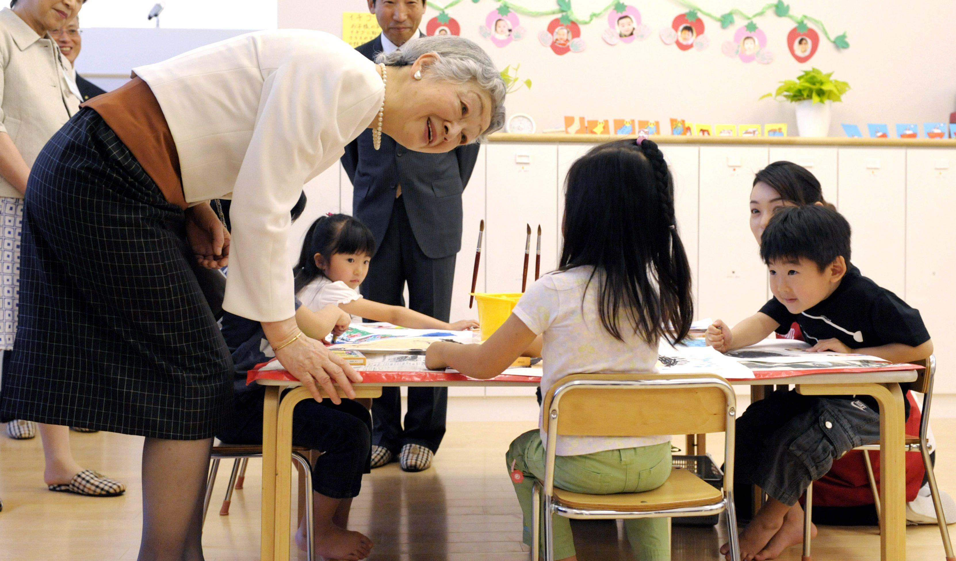 Japanese Empress Michiko visits Shiseido's Kangaroom daycare center in Shiodome in Tokyo, May 15, 2009.