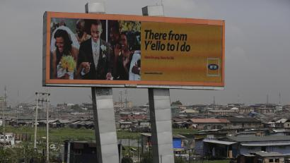 In this photo taken Tuesday, Nov. 17, 2015, an MTN advertisement is seen on a giant electronic board over a slum in Lagos, Nigeria. Nigeria's authorities have levied a US dlrs 5.2 billion fine to Africa's largest telecommunications company, MTN, for having 5.2 million active but unregistered SIM cards, which authorities allege are a matter of national security in Nigeria and may have caused deaths. The dlrs 5.2 billion fine is far more than any company has been fined anywhere in the world according to industry expert John Strand of Denmark-based Strand Consult.