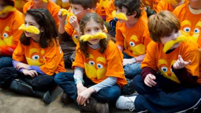 School children attend the National Education Association's 15th annual Read Across America Day