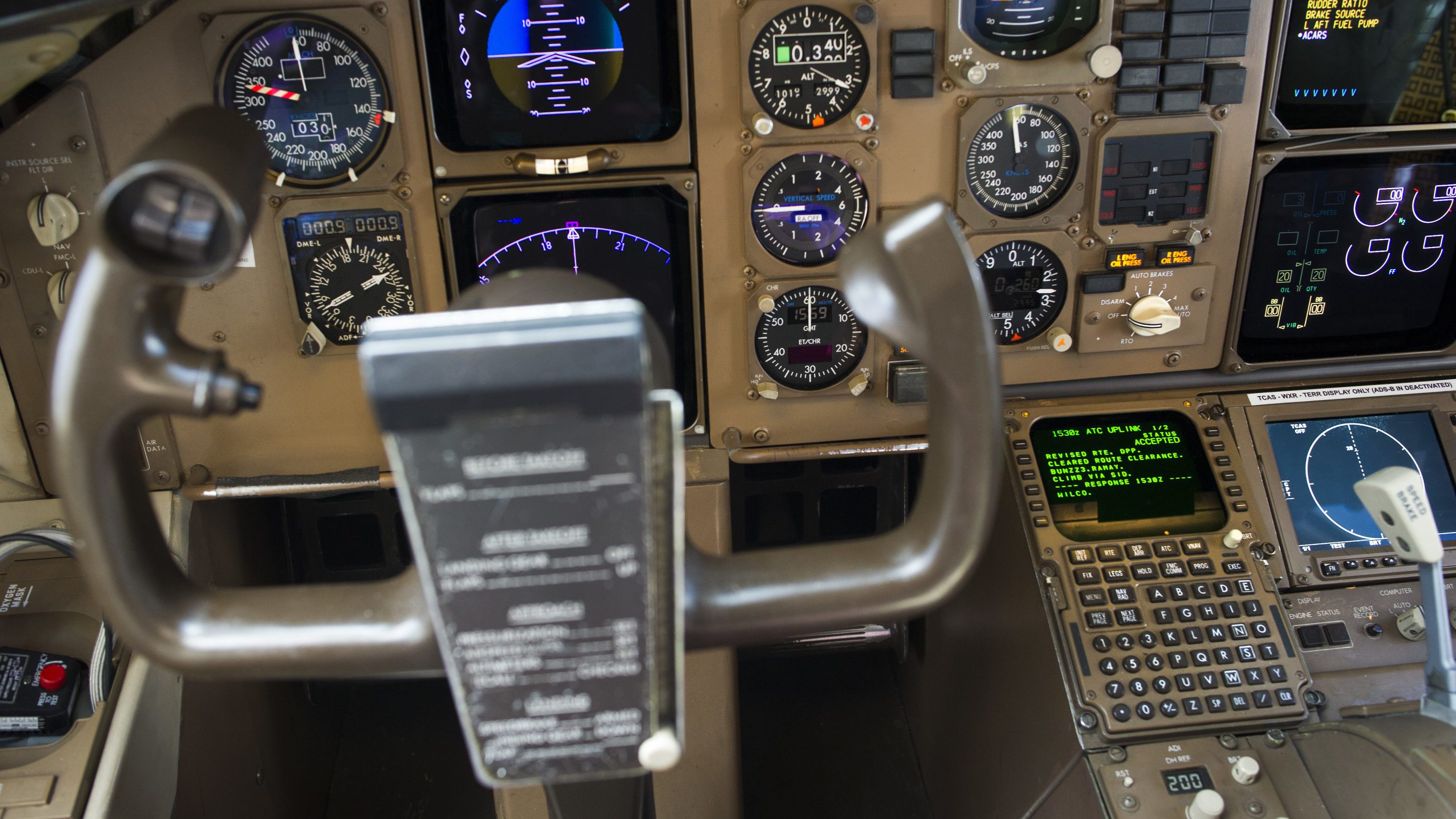 Data Communications Data Comm technology, lower right, is seen in the cockpit of an UPS Boeing 767-300F aircraft at Dulles International Airport Air Traffic Control Tower in Sterling, Va., Tuesday, Sept. 27, 2016. Data Comm gives air traffic controllers and pilots the ability to transmit flight plans, clearances, instructions, advisories, flight crew requests, and reports via a digital message service.