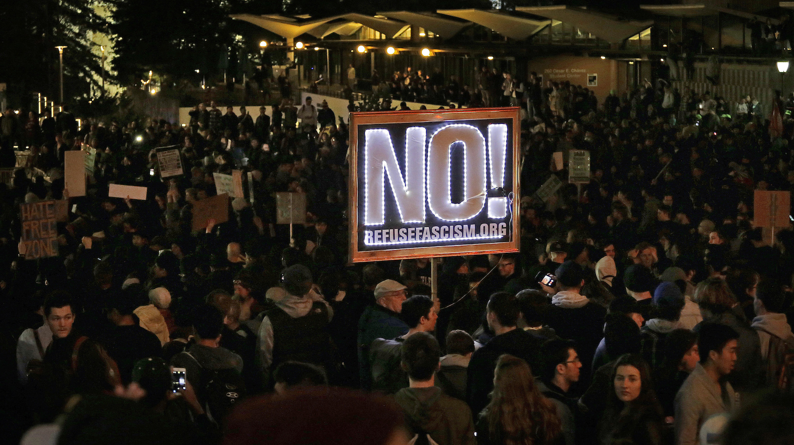 Protestors against a scheduled speaking appearance by polarizing Breitbart News editor Milo Yiannopoulos fill Sproul Plaza on the University of California at Berkeley campus on Wednesday, Feb. 1, 2017, in Berkeley, Calif. The event was canceled out of safety concerns after protesters hurled smoke bombs, broke windows and started a bonfire. (AP Photo/Ben Margot)