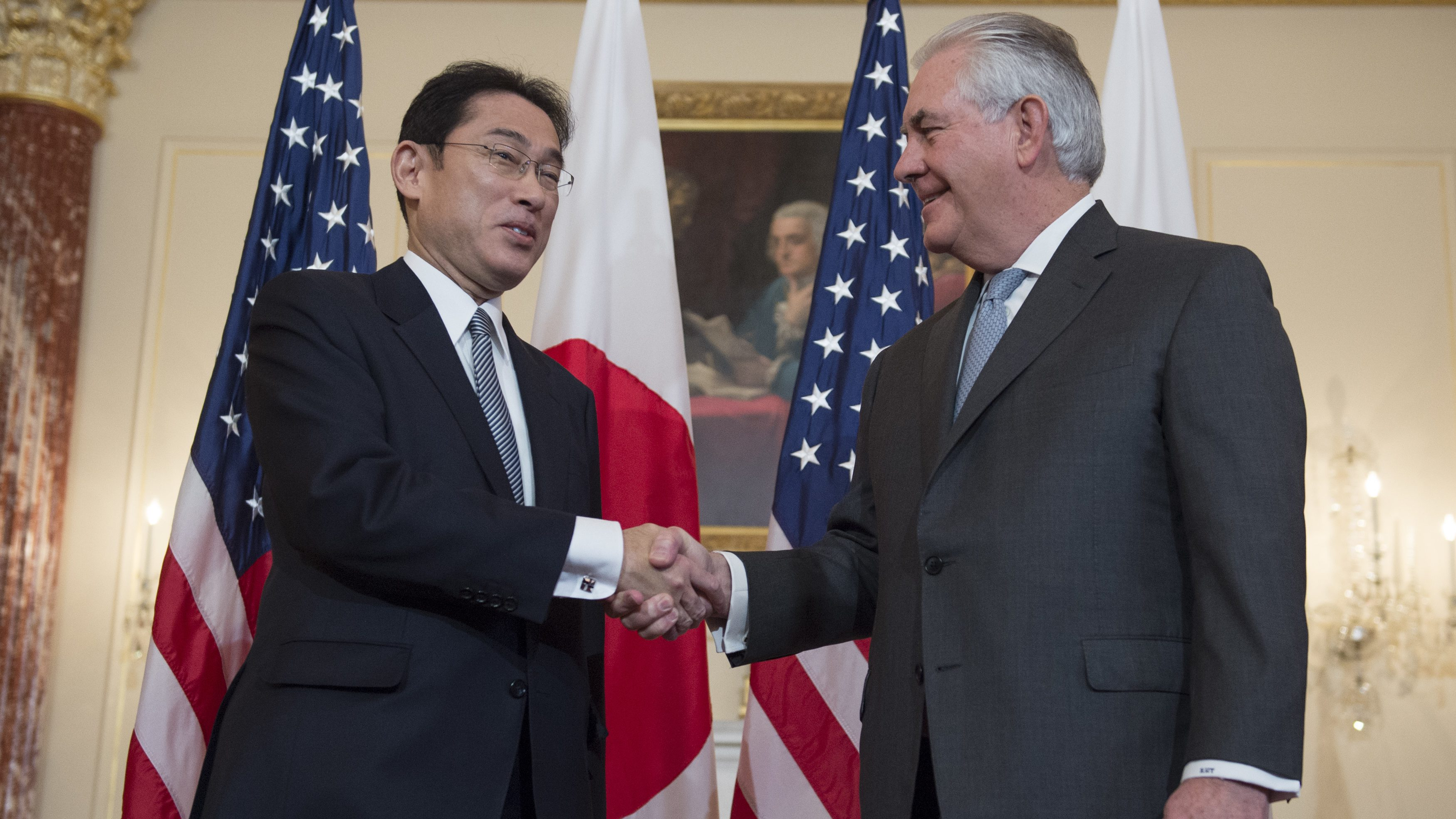 Tillerson shakes hands with Japans foreign minister Fumio Kishida in Washington.
