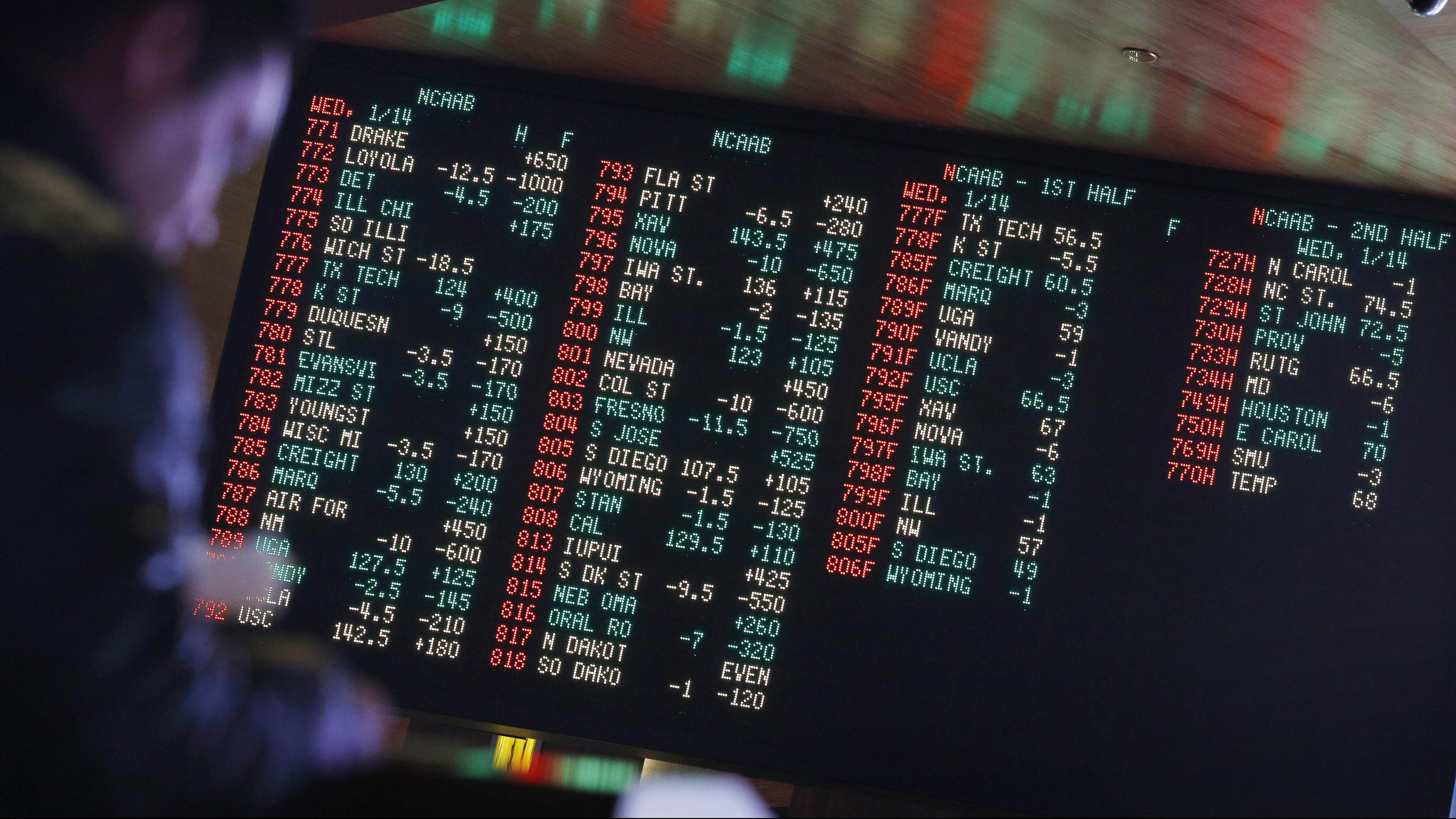 Odds are displayed on a screen at a sports book owned and operated by CG Technology in Las Vegas.