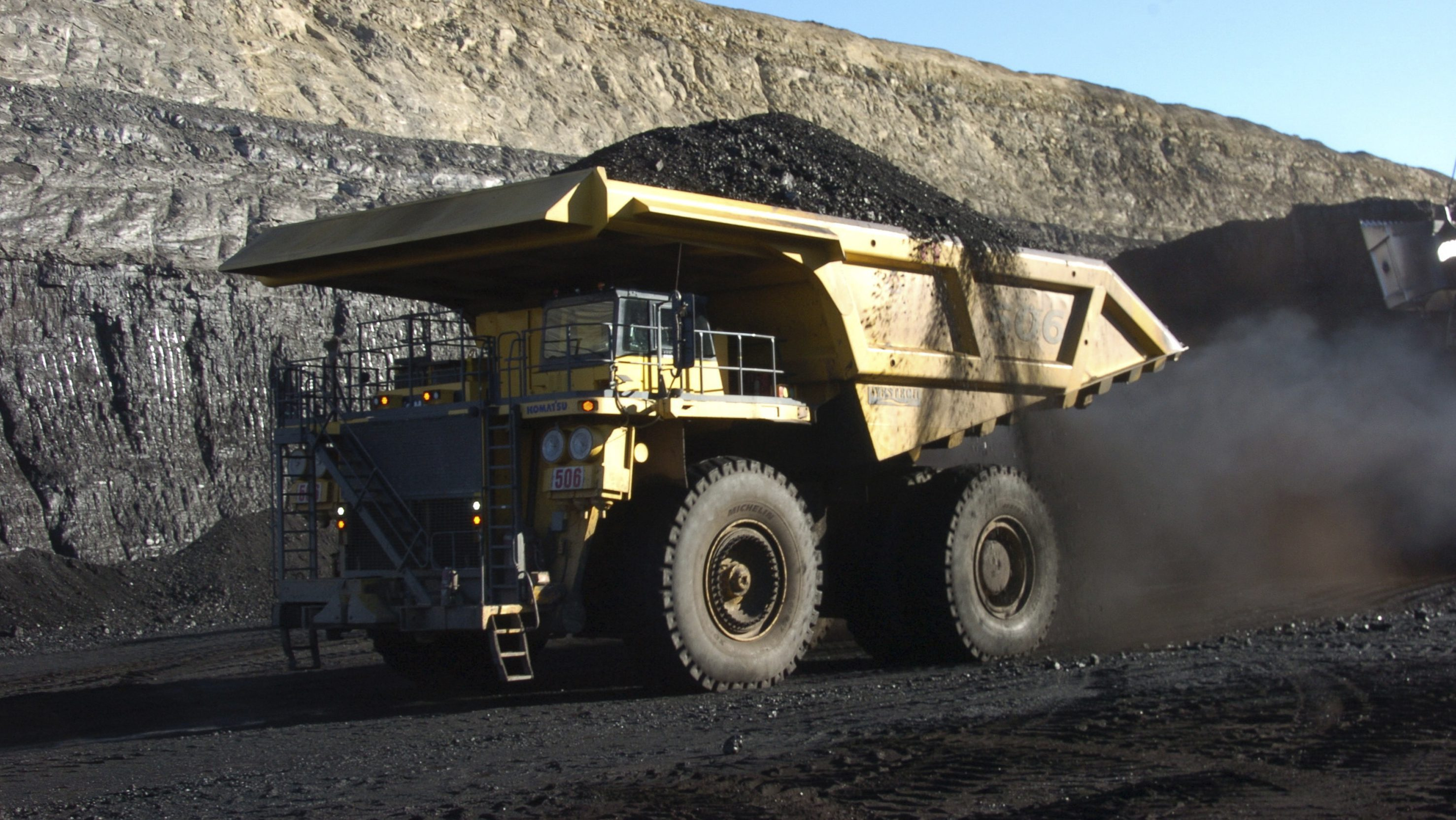 FILE - In this Nov. 15, 2016 file photo, a haul truck with a 250-ton capacity carries coal from the Spring Creek strip mine near Decker, Mont. President Trump's latest move to support coal mining is unlikely to turn around the industry's prospects immediately. Experts say the biggest problem faced by the mining industry today isn't a coal shortage of coal or even the prospect of climate change regulations, but an abundance of cheap natural gas. (AP Photo/Matthew Brown, File)