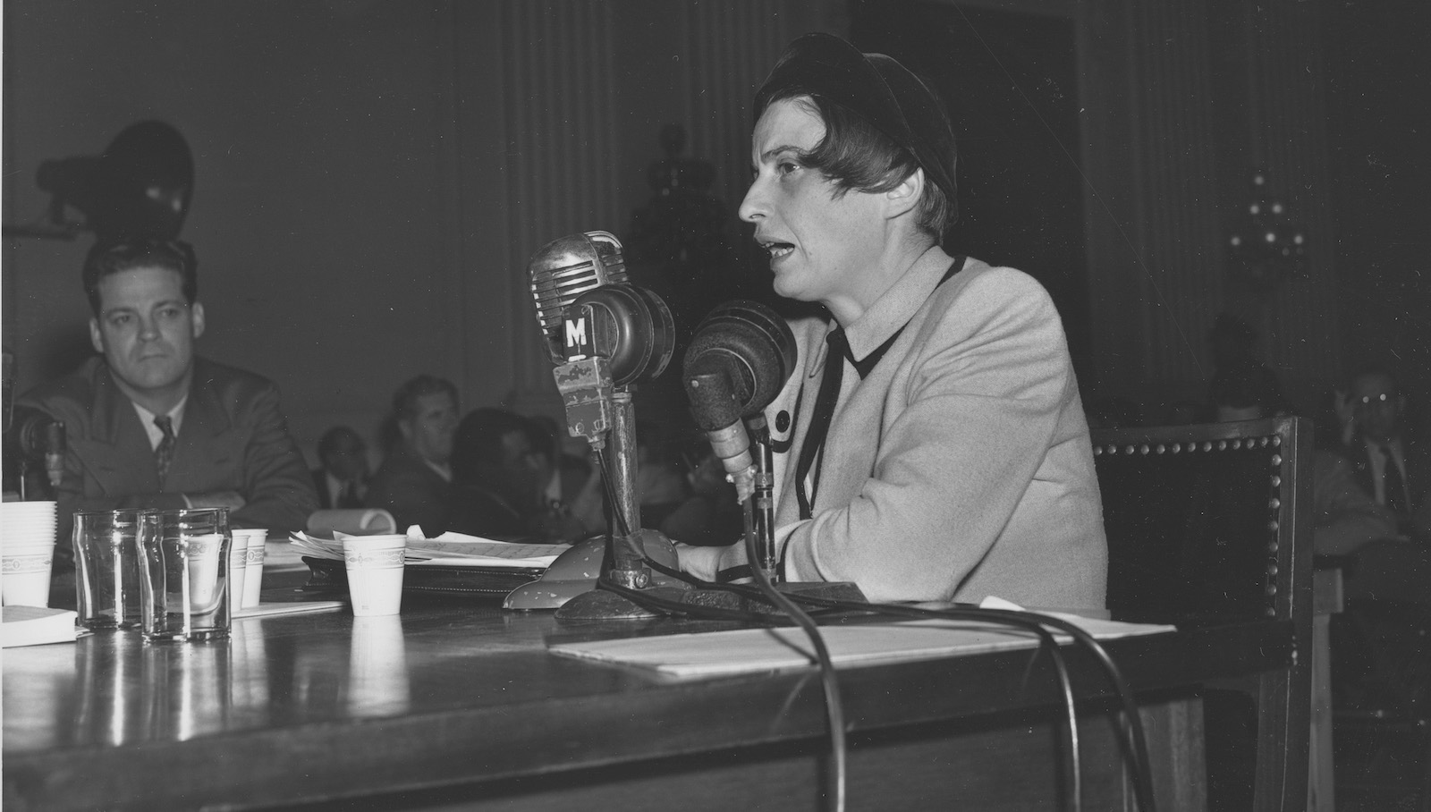 "Ayn Rand, Russian-born American screenwriter and novelist, discusses the film ""Song of Russia"" before the House Un-American Activities Committee in Washington, D.C., Oct. 20, 1947.  The committee is investigating the movie industry for Communist associations during the McCarthy era.  (AP Photo)"