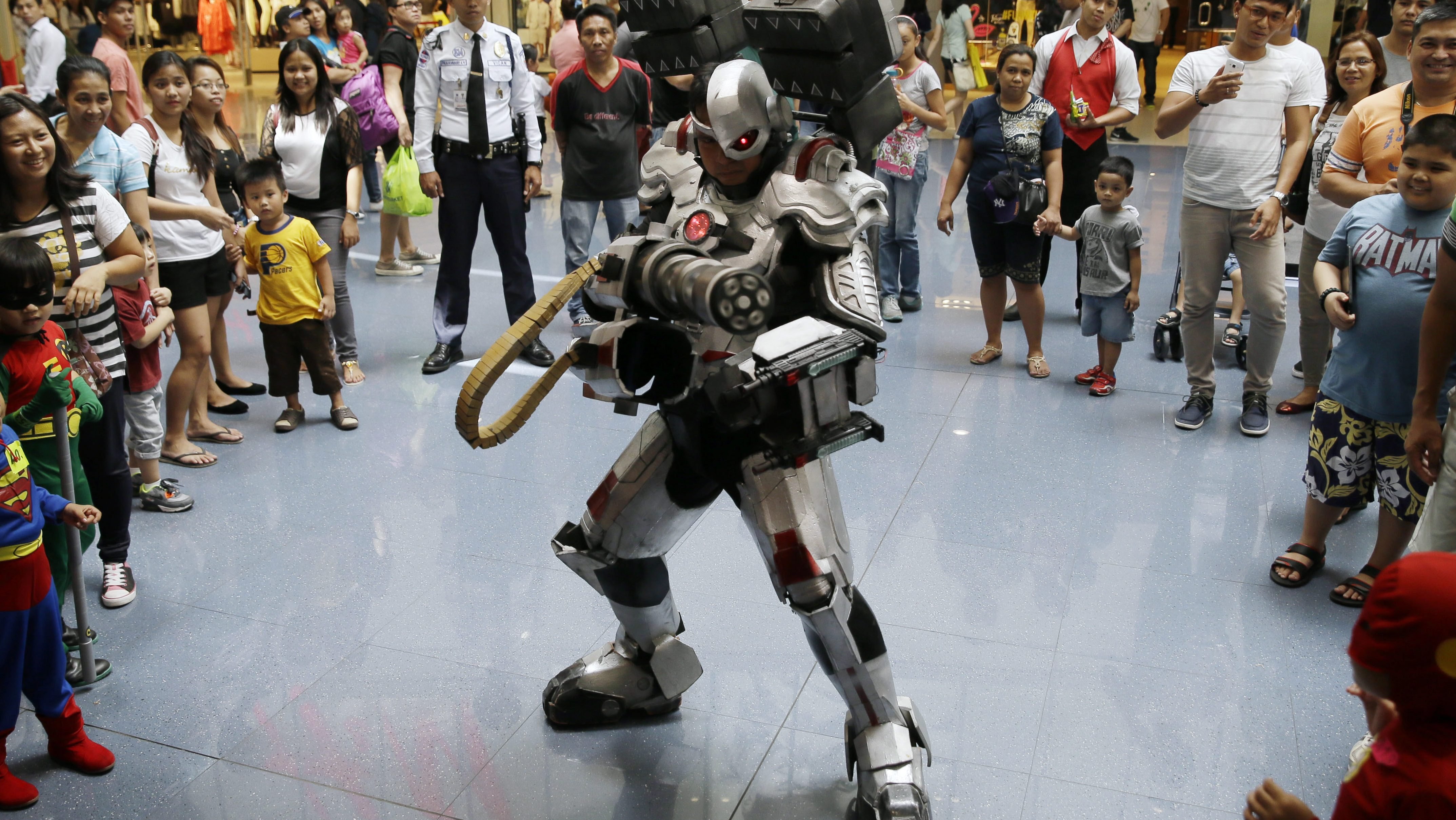 A Filipino fan, in a Cyborg costume, poses during the gathering of DC comics super heroes at the country's largest shopping mall in an attempt to establish a world record for the most number wearing their super heroes costumes Saturday, April 18, 2015 at suburban Quezon city northeast of Manila, Philippines. Hundreds of fans from babies to adults turned out for the attempt but some have to be turned down because they were not dressed as DC comic characters. The most popular are Superman and Batman. (AP Photo/Bullit Marquez)
