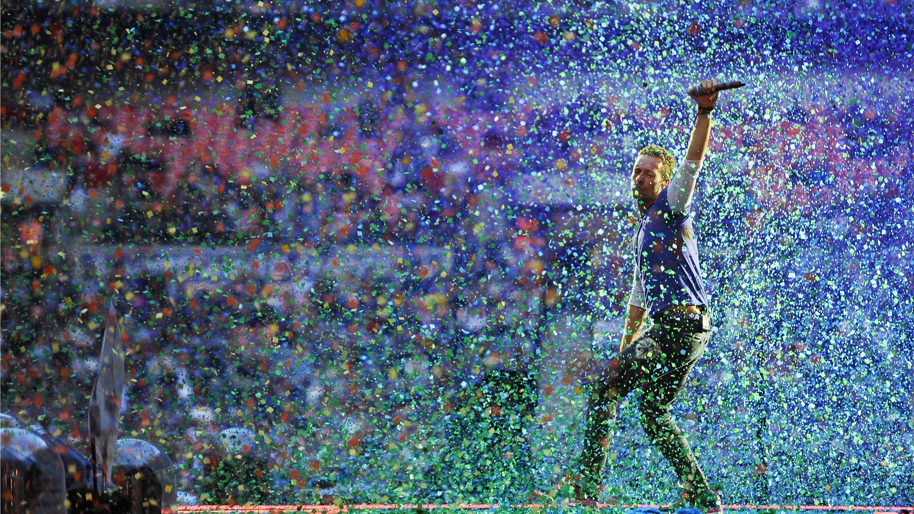 Photo by: KGC-138/STAR MAX/IPx 6/15/16 Jonny Buckland, Chris Martin and Will Champion of 'Coldplay' performing at Wembley Stadium in London.