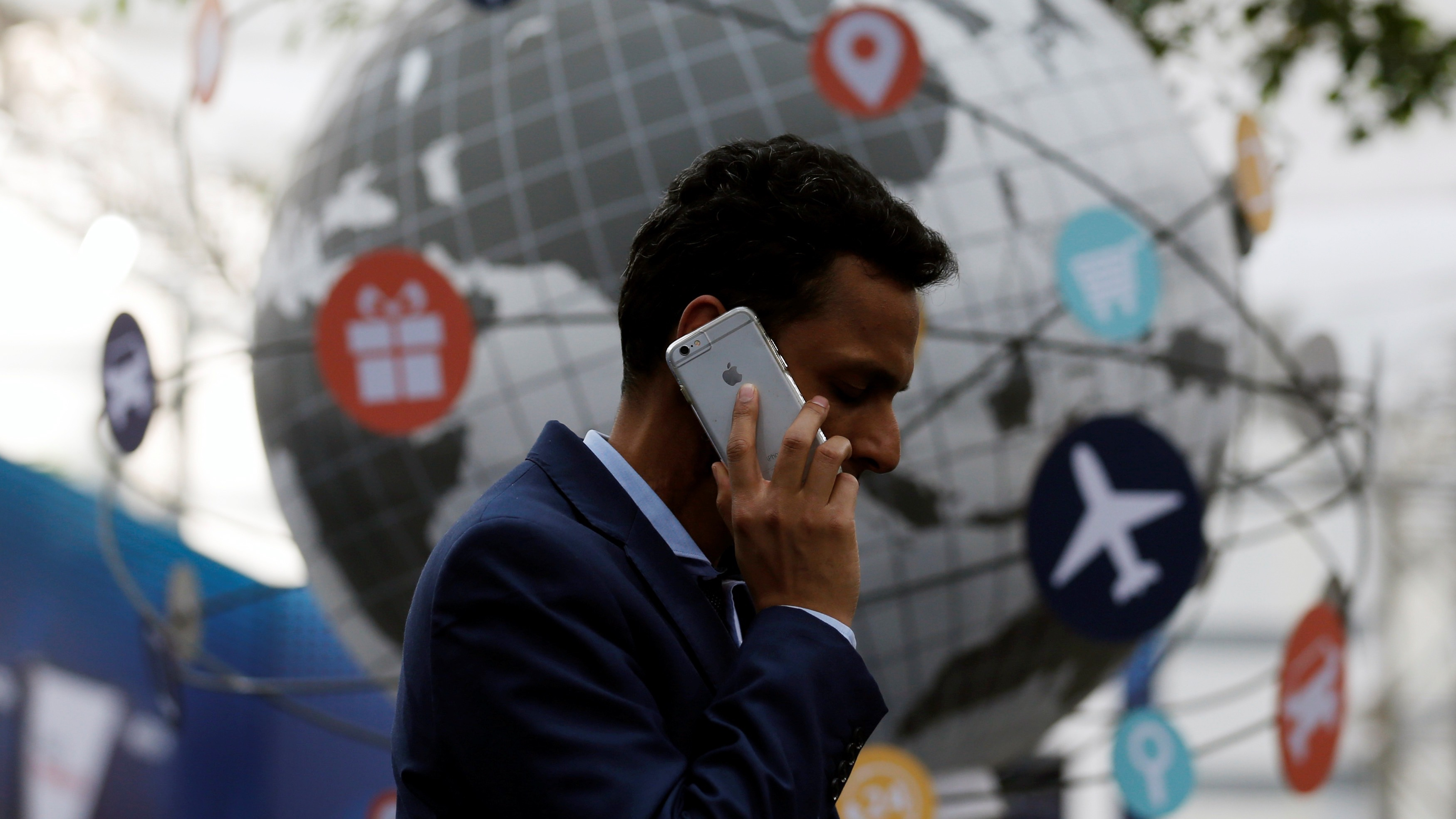 A delegate speaks on the phone as he attends the National Association of Software and Services Companies (NASSCOM) India Leadership Forum in Mumbai, India February 16, 2017. REUTERS/Danish Siddiqui - RTSYWWD