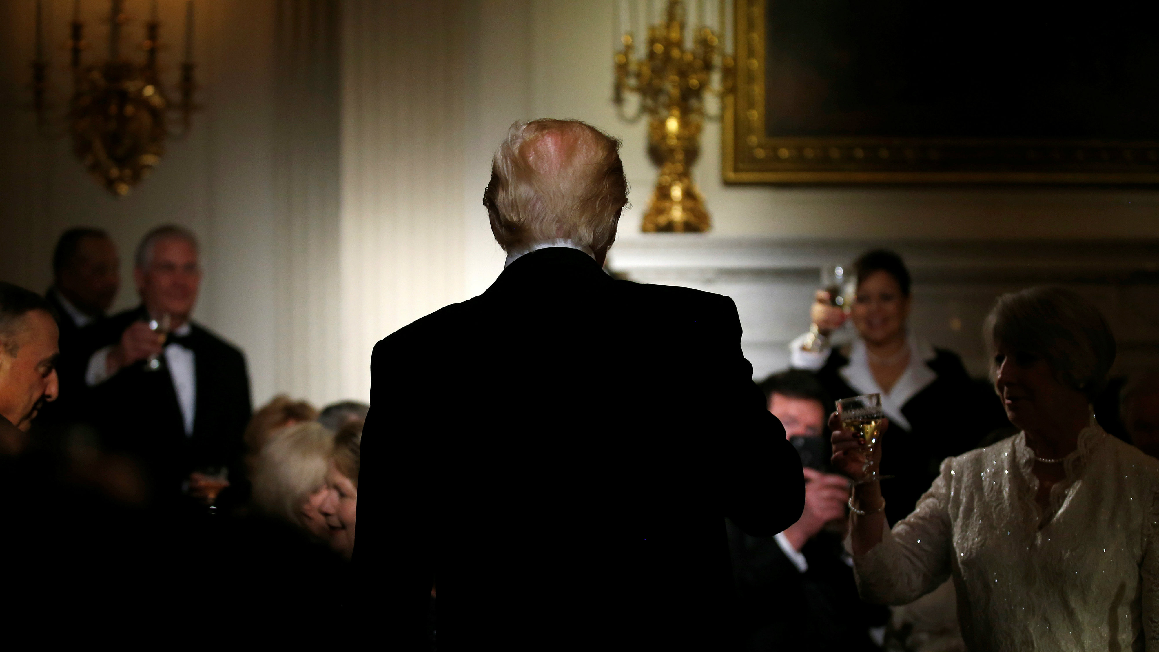 U.S. President Donald Trump stands during a toast giving by Virginia Governor Terry McAuliffe during the Governor's Dinner in the State Dining Room at the White House in Washington, U.S., February 26, 2017. REUTERS/Joshua Roberts