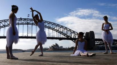 ballerinas from the australian ballet in front of sydney harbour bridge