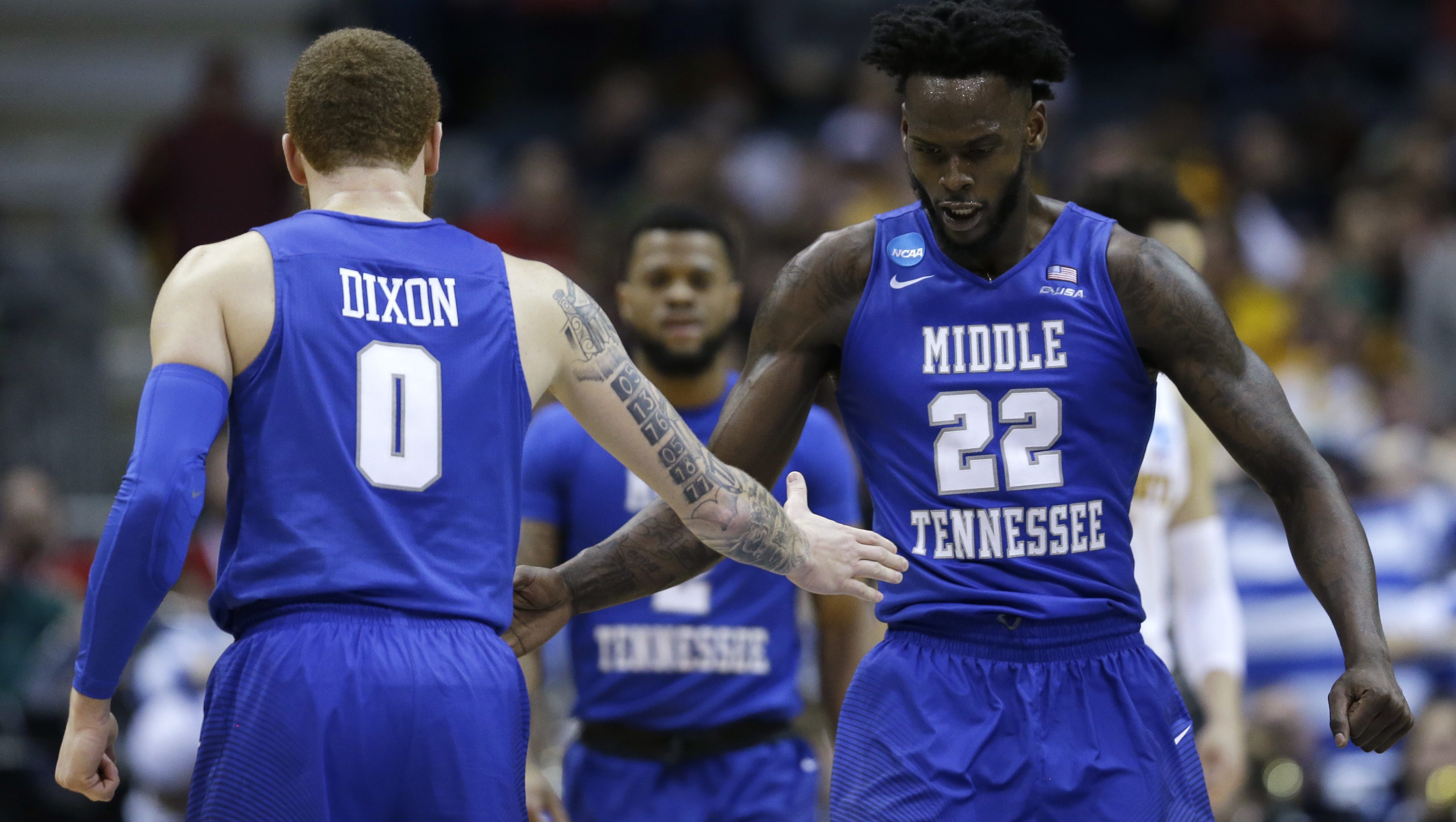Middle Tennessee State's JaCorey Williams (22) and Tyrik Dixon (0) celebrate during the second half of an NCAA college basketball tournament first round game against Minnesota Thursday, March 16, 2017, in Milwaukee.