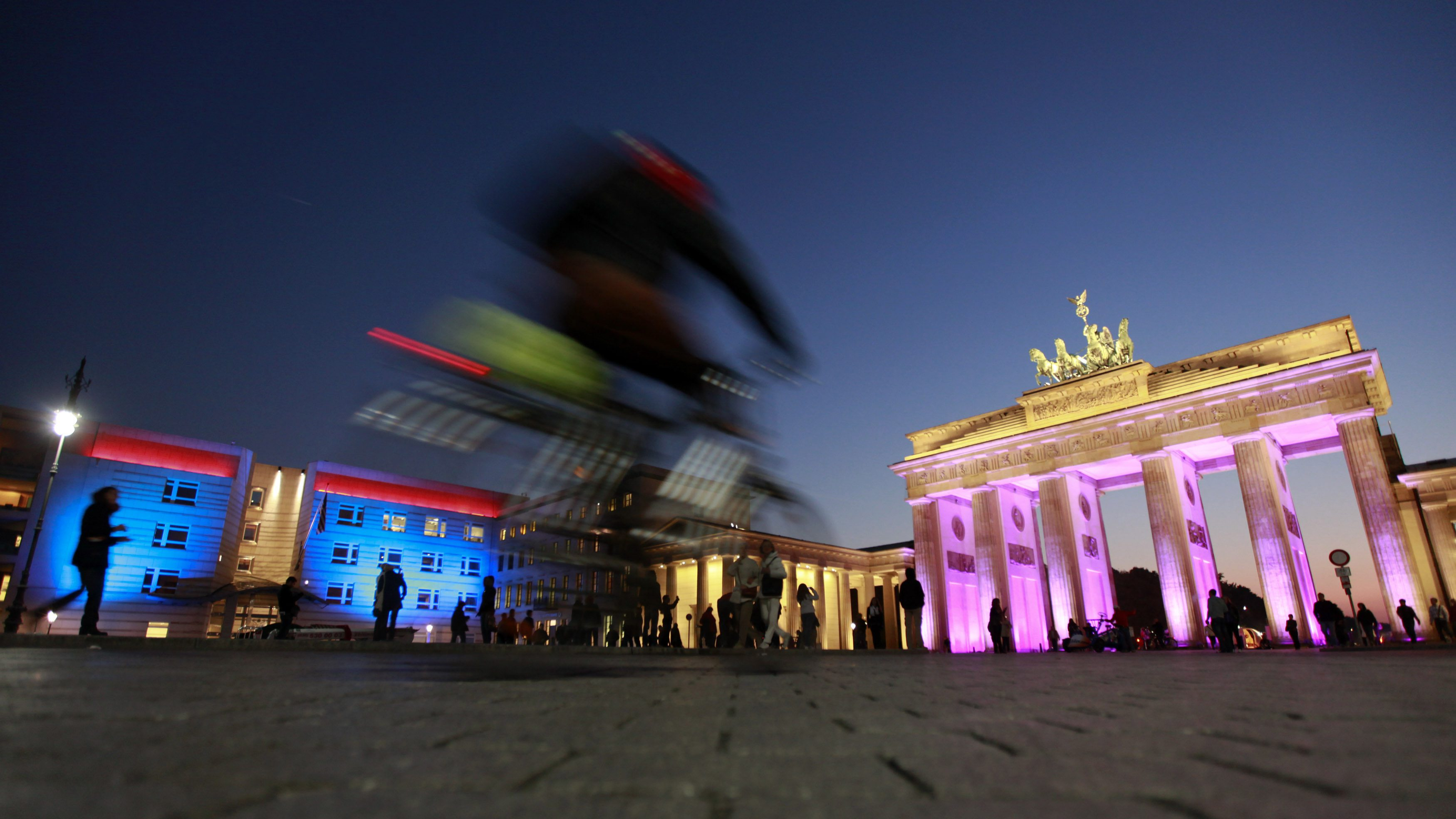 The Brandenburg Gate (R) and the U.S. embassy (L) are illuminated during a rehearsal for the upcoming Festival of Lights in Berlin October 12, 2010. Several landmarks of the German capital, including boulevards, squares, towers, historical and modern buildings, will be illuminated during the festival.