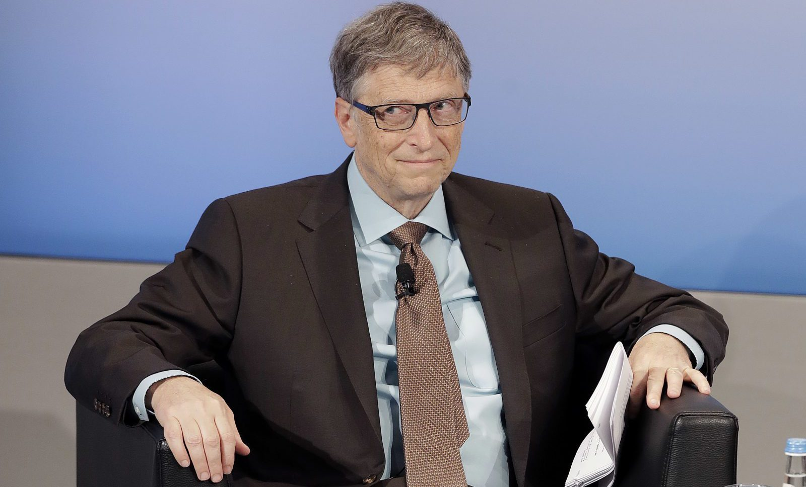 Microsoft founder Bill Gates sits in his chair during the Munich Security Conference in Munich, Germany, Saturday, Feb. 18, 2017. The annual weekend gathering is known for providing an open and informal platform to meet in close quarters. (AP Photo/Matthias Schrader)