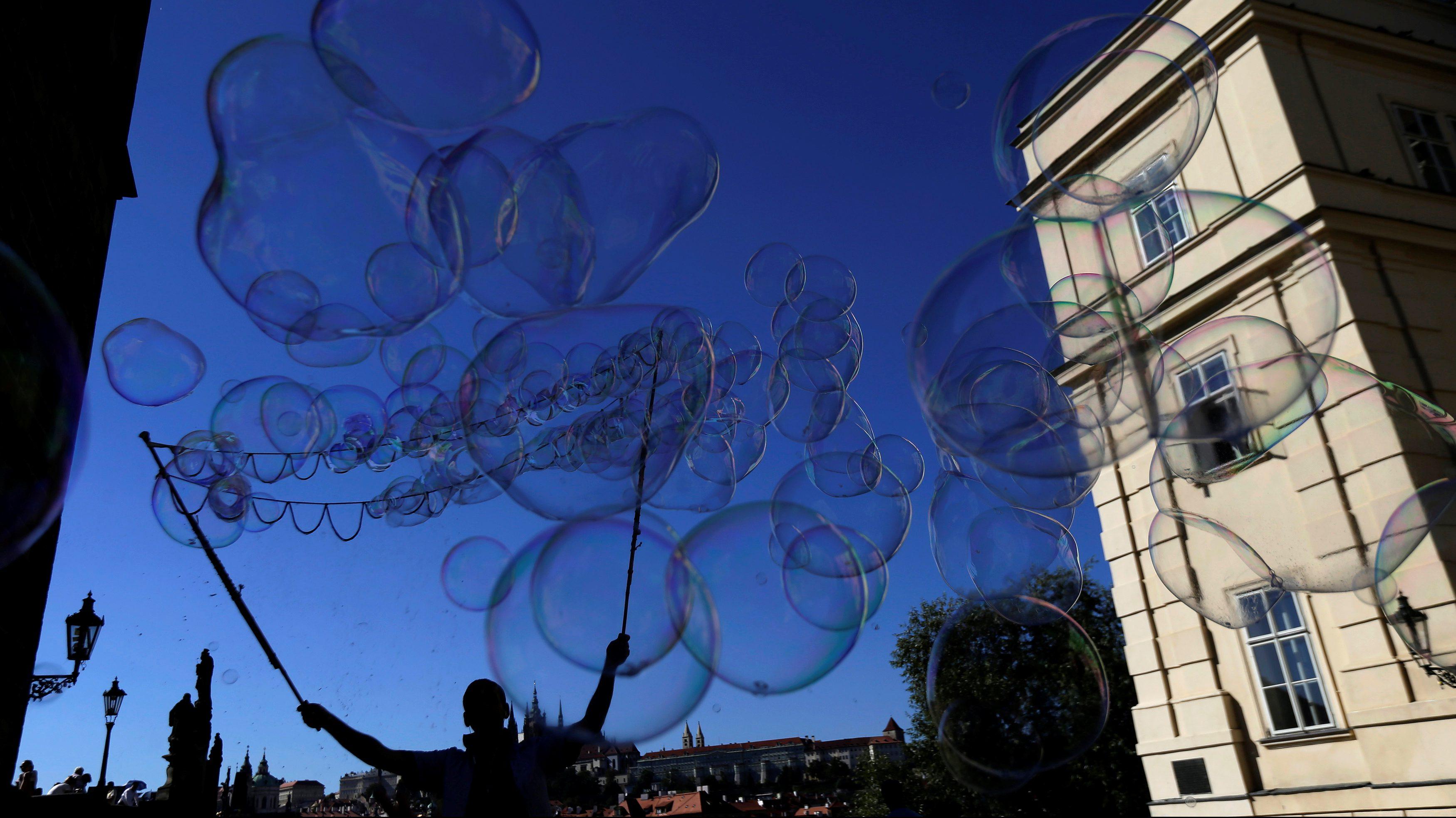 A street artist performs with soap bubbles in Prague, Czech Republic August 31, 2016.